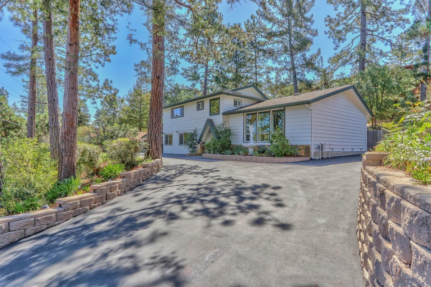 Wonderful opportunity to own this 4 bedroom 2.5 bathroom home nestled among the pine tree's in Scotts Valley. This spacious 2782 sqft residence boasts many upgrades within the past few years including new interior and exterior paint, new windows, new carpet, remodeled master bathroom, new interior doors and hardware, a commercial grade driveway and updated landscaping. The 50 year presidential roof was installed in 2008 and has a ton of life left in it!  In addition to the 3 large bedrooms upstairs, there is an additional private office area upstairs and a 450+ sqft in-law unit with private living room, bedroom and bathroom on the first floor. Driveway has room for two RV's(hookups included) or boats/toys  including a two car covered carport. The backyard has a large covered patio area, raised decking with synthetic lawn and a 300 sqft upstairs patio area to enjoy serene views of the distant mountains. Plenty of storage areas on site! This a truly a beautiful property to call home!