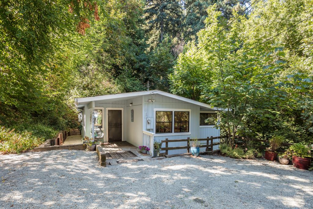 Charming 2 bedroom 1 bathroom cottage at the end of cul-de-sac overlooking forest of Moody Gulch. Hardwood floors, lovely light from windows and skylights. Spacious bedrooms and vaulted ceilings Kitchen opens to dining and living areas with breakfast bar and sliding glass door leads to nice size deck. central heat plus wood-burning stove. Sunny, bright and serene privacy with lovely back deck and flat yard. Large basement storage area with Laundry hookups. Comcast internet and public water. Fantastic Redwood Estates community, home is close to  new pool, community center, 2 playgrounds, fire station, post office, store and Nonno's Cafe. Great commute location, 7 minutes to town, and best Los Gatos schools: Lexington Elementary (IB Program), Fisher Middle, Los Gatos High.