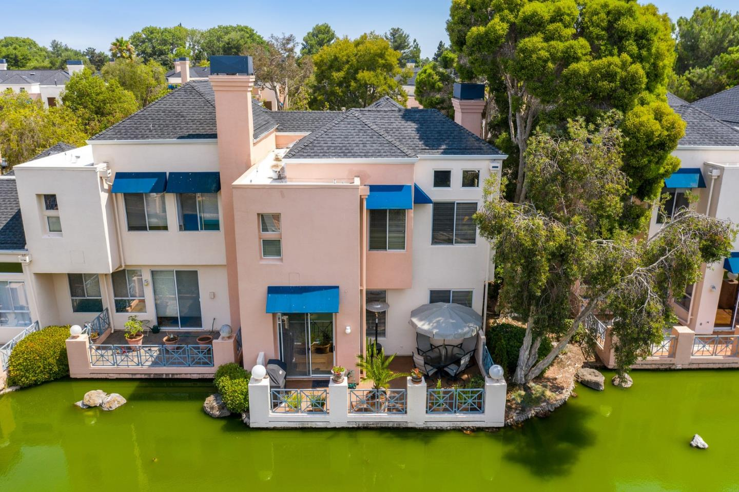 Situated along a private waterway in one of only two gated communities in Redwood Shores, this expansive home with designer updates and spectacular details throughout, boasts a rare floor-plan with 4 full bedrooms and 3 full bathrooms.  Fab kitchen featuring custom cabinetry, a paneled refrigerator, top-of-the-line stainless steel appliances, gorgeous granite counter-tops & a wine refrigerator.  Expansive primary bedroom featuring water views, vaulted ceilings and an en-suite luxe bathroom boasting dual vanity sinks and a walk-in shower.  Don't miss the spacious walk-in closet.  Two more bedrooms upstairs, one with its own private balcony, plus a bonus area that could be used as an office area or wellness space. Located within award winning Belmont Redwood Shores School District (buyer to verify enrollment). Located near Bay trails, parks, tennis courts, the Marketplace shopping center, Bay Club and major Silicon Valley employers. HOA:  $510 per month. RSOA:  $84.00 per year