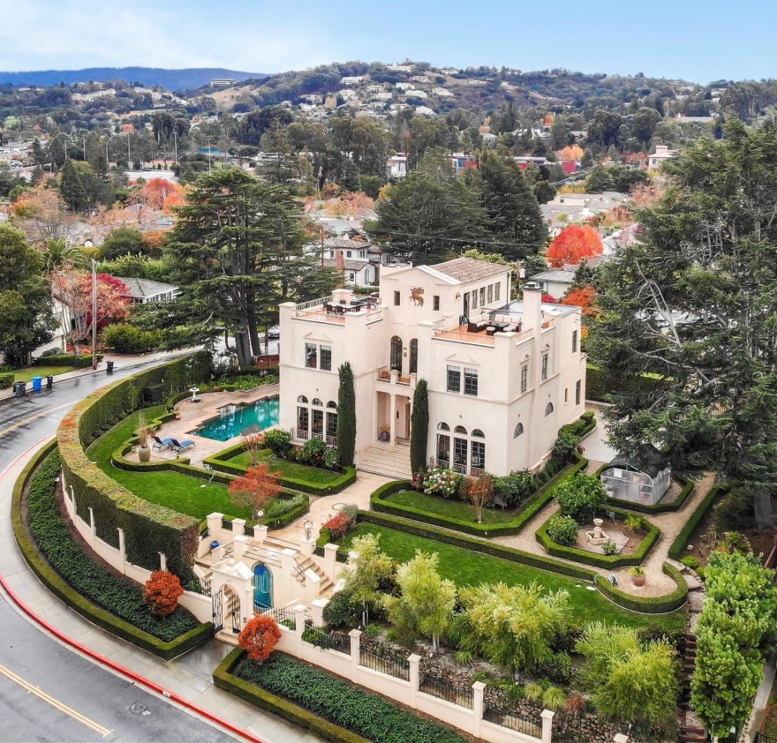 This one of a kind property, designed by the renowned Italian architect Peter D. Canali is situated on a 17,500 sq/ft knoll in San Mateo's coveted Baywood neighborhood. The 4,800+ sq/ft of living space consists of 12 rooms including 3 suites, a central reception area, an elegant living room, and a banquet-sized dining room. Also included are a chef's kitchen with an eating area, meditation/4th bedroom, executive office and a penthouse entertainment-family room with a full bar and French doors to 2 terraces that offer magical 360-degree views of the Peninsula. All 4 floors, including the full basement, can be accessed by an elevator as well. The surrounding grounds include a gated carriage entrance, heated pool, greenhouse, a private electric gated driveway that leads to a 2-car garage with an Au-pair studio above complete with a kitchen and full bath. This professionally landscaped home is within walking distance to downtown San Mateo and minutes from San Francisco and Silicon Valley.