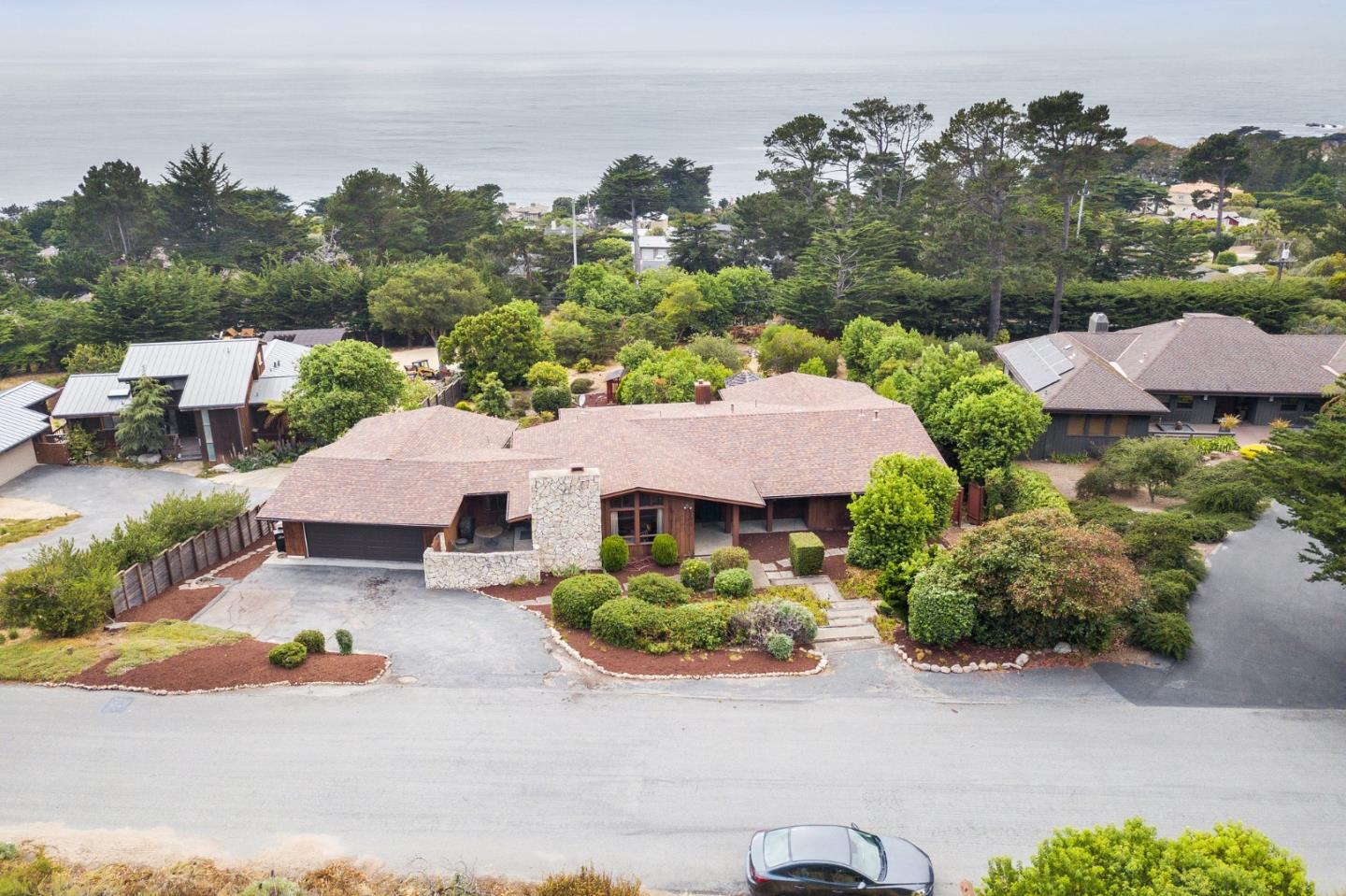 Located in a peaceful and magical area of the Carmel Highlands, this home sits in a place where the mountains meet the sea and the whales pass by a couple time a year. The first time on the market in 47 years, its ready for someone new to shape this space and the canvas to make it your place. The four bedroom, three bath home has all of the areas to create a standalone everyday escape. Three bedrooms and two baths on the main floor, with an additional bedroom suite and family room downstairs. Other extra areas include the large backyard, separate gym/ workshop, den, and bonus space. And you can walk down the road and access a secluded beach. This is where you can design your future. What will your 40+ years look like?