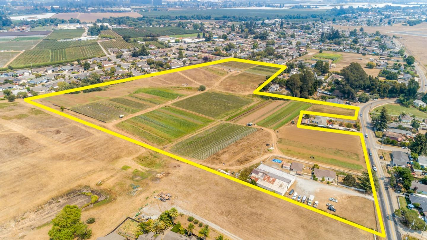 The Santora Ranch.  Originally an orchard property with an apple packing shed, is now composed of 17.5 acre row crops, a 5,600 sf packing shed, and the original farm house.  Plenty of room to park vehicles.  Agricultural well and pump for farm land. City water for house and out buildings.