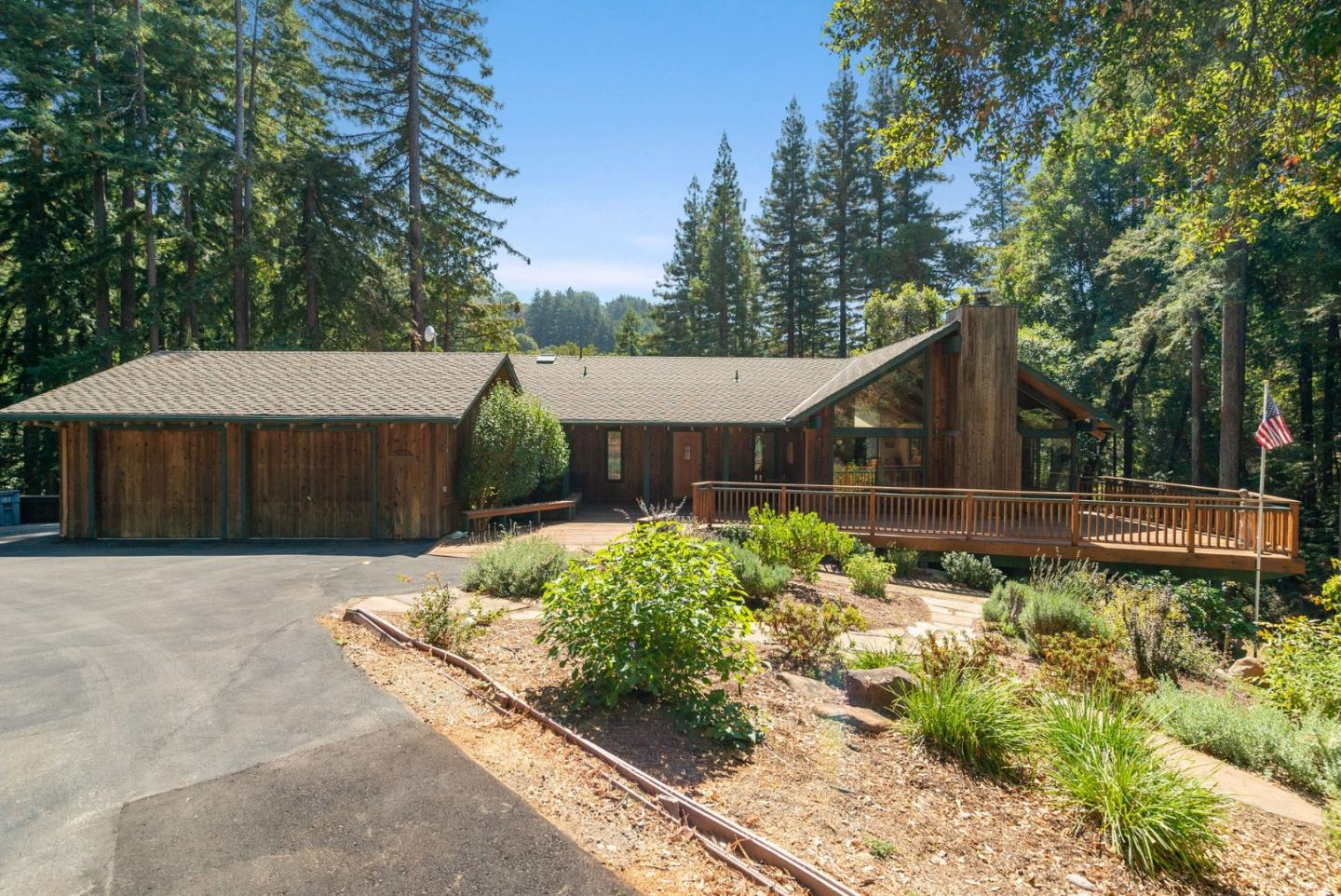 Just Dropped ~$50,000! Nestled in the redwoods above the City of Scotts Valley, this beautiful home is located just 3-miles from Glenwood Drive and 5-miles from Scotts Valley High. Host family and friends in the large living room with vaulted, open beam ceilings. The floor to ceiling windows provide phenomenal views of the garden and surrounding redwoods. The property lives like a single level home with the master bedroom, living room, kitchen and dining room on the entry level. The kitchen is equipped with granite counters and a walk-in pantry with access to the back deck. Sit and enjoy the spectacular sunrises/sunsets and majestic beauty of the surrounding forest from the front and back decks. This home has ample storage with a workshop, storage shed, 2-car garage and a storage space under the home. The lot is highlighted by space for gardening, two dog runs, well pump house, swing set and whole house generator. Come see this beautiful property today!