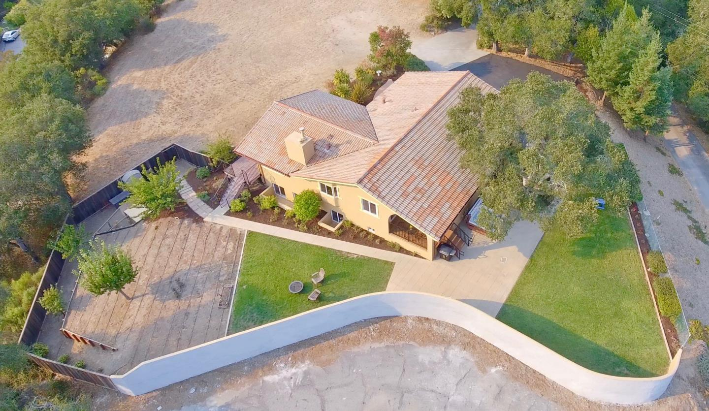 LIVE ON TOP OF THE WORLD in this stunning home on over 1.1 acres that gives you INCREDIBLE views that are almost 360 degrees, giving you sunset and sunrise views all day. From Scotts Valley to the Soquel Redwoods and the ocean, it does not disappoint. With a spacious and flowing floor plan that brings in a lot of natural light from the many windows and high ceilings, everyone can have their space or gather around the various gathering spots like the large living room and family room, each with their own fireplace. OR... A beautifully updated kitchen with granite counters and a center island, stainless steel appliances and access to a side patio area which is perfect for morning coffee. There is all new exterior paint and most of the interior has been repainted, and it looks AWESOME! Beautifully landscaped front and rear and also a large area for your vegetable garden awaits you! Walk or bike to shopping, dining, AWARD WINNING SCHOOLS, and the beach and state parks are 10 minutes away!