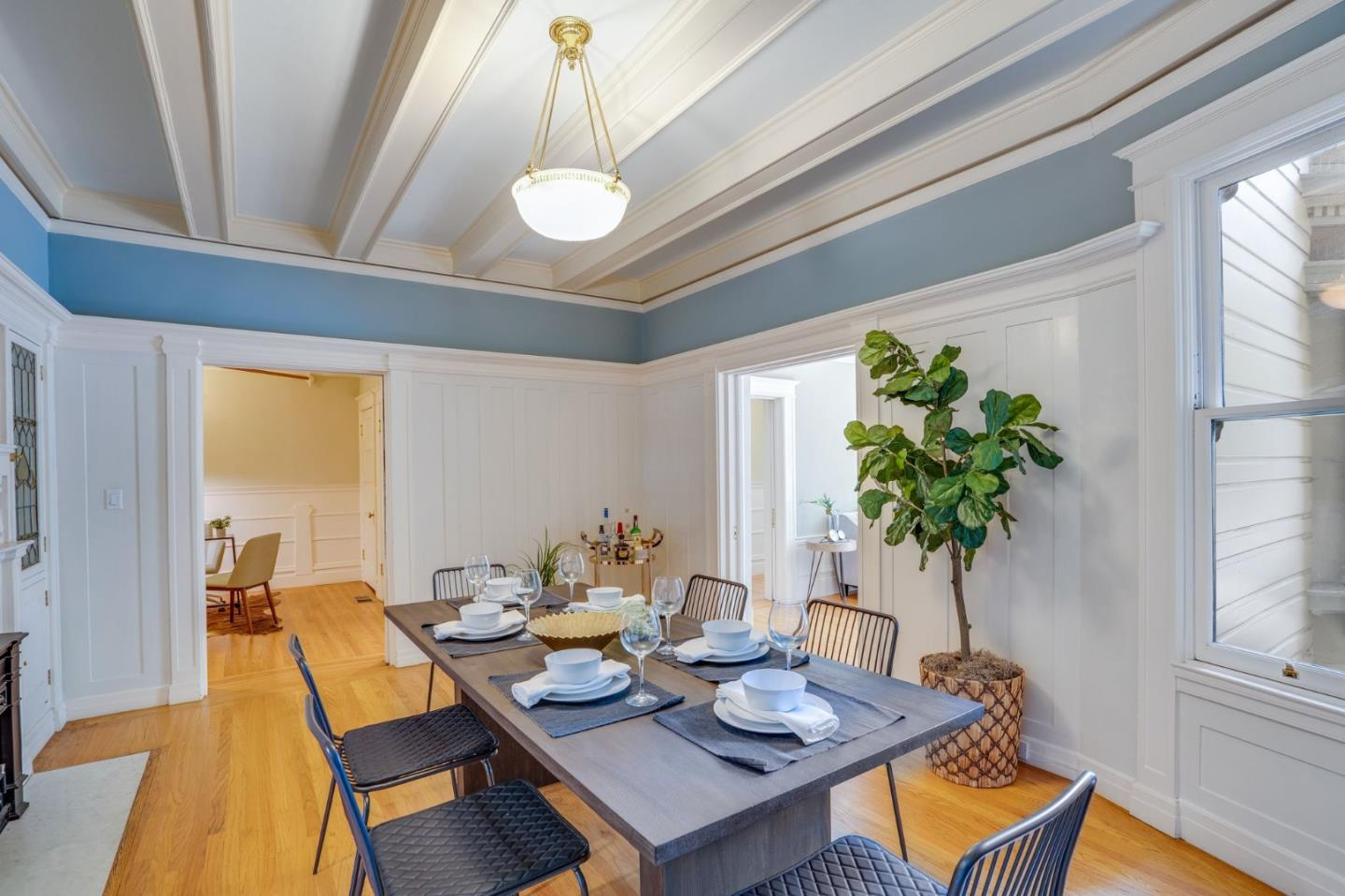 Elegant, Victorian TIC unit in the heart of the vibrant and historic Haight Ashbury district. This exceptional unit boasts 2 generously sized bedrooms, 2.5 bathrooms, and sits in a multi-family home enriched with period details. From its curved bay windows, century-old wainscoting, refinished light fixtures, and Corinthian columns that restored its Victorian look, this gem proves itself to be a turn of the century charmer. Rooms are boasting with large foyer, formal living and dining rooms with timeless fireplaces and mirrored mantles. Chef's kitchen with high-end stainless steel appliances, abundant cabinetry, and granite countertops. Hardwood floors, classic crown molding, wainscoting, and restored antique lighting throughout. Relaxing shared yard with garden and patio. Enjoy a prime location, just steps from revered San Francisco landmarks, prime shopping, and a growing number of popular restaurants. Golden Gate Park, Buena Vista Parks, Cole Valley, NoPa, and main freeways nearby!