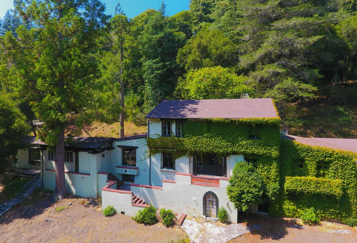 "One-of-a-kind 12.8 acre estate on Branciforte Creek featuring the original 7 BR 6000+SF Mediterranean villa ""Casa de Montgomery"" built in 1932, with attached guest unit plus an 8000+SF wing built in 1972 that added 17 BR with commercial kitchen, dining hall, high ceilings & ADA hallways, for total 13,955 SF, 26 BR, 6 full baths & 14 half baths. There are engineering, plans & former application to demo everything & rebuild as a 100-bed senior assisted living facility, OR SIMPLY UPDATE THE VILLA AND RE-ENGINEER THE 8000+SF WING FOR GIANT HOME SHOP, STUDIO OR 30+CAR/TOY BARN! Other Level 5 Use possibilities include renovating in place as a school, religious or retreat center, corporate compound or subsidized housing. Main water source is well with poly tanks. Also has water rights & pumps at creek that once fed a large tank for the fire sprinkler & irrigation systems, plus 5 dry ponds from a now-defunct treatment system that can become scenic water features once a new system is installed."