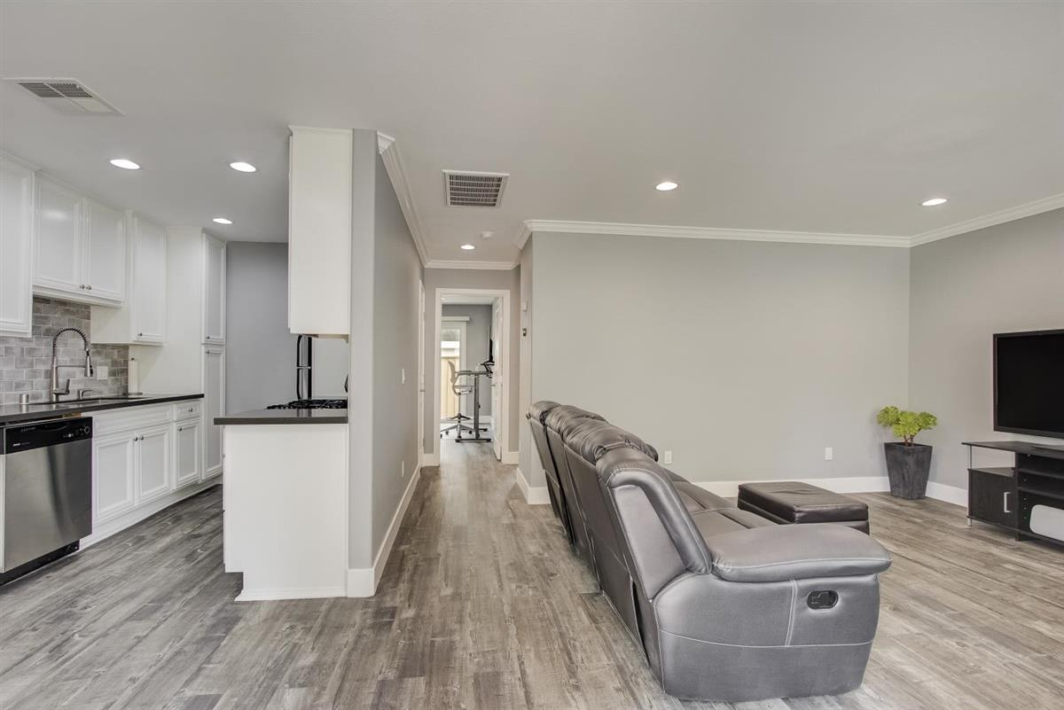 """Super sleek unit in the heart of Silicon Valley close to Google (less than 10 minutes away via bike on an easy, paved trail), restaurants, shopping, schools and freeways. Small and quiet 19-unit community, this impressive unit is dialed to a """"T"""". The entire interior has recently been redone with modern colors and updates. Kitchen showcases modern stone countertops, a large sink and faucet, and white cabinets. Modern hardwood floors and crown moldings extend throughout the home, highlighted by recessed LED lighting. The stunning bathroom renovation features new shower tile walls and shower/bath faucets, a new countertop and sink faucet, and a frameless sliding glass shower door. Both bedrooms have mirrored closet doors and new paint has been applied throughout. The home also contains a new central HVAC system, controlled by a smart thermostat, that is unique to this unit as well as a one-car garage. A private rear patio, perfect for relaxation, rounds out this home's amenities."""