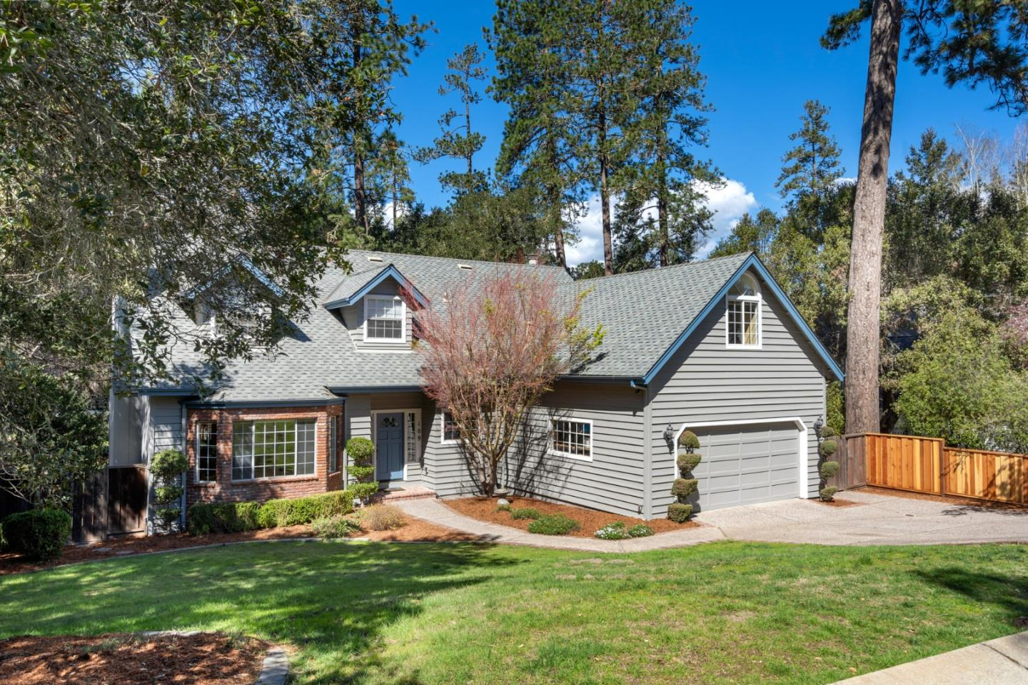 Centrally located in Scotts Valley in the coveted Pinewood Estates, this spacious 4 bedroom + Bonus Room, 3 bathroom home has been meticulously maintained and is looking for a new family to call it home!  Step inside and you'll find a formal dining and living room, spacious kitchen with granite countertops, a gas range, and breakfast nook.  Also located downstairs are a bedroom and full bathroom, perfect for guests or a senior family member. Head upstairs where you'll find two more bedrooms, a second full bathroom, laundry room, large bonus room, and sprawling master suite.  The master suite features a large walk-in closet and bathroom with a jetted tub and walk-in shower. Other property features include two fireplaces, a two-car garage, new redwood deck, and storage area beneath the house complete with a utility sink, electricity, and a dog door that leads to a fenced-in dog run.