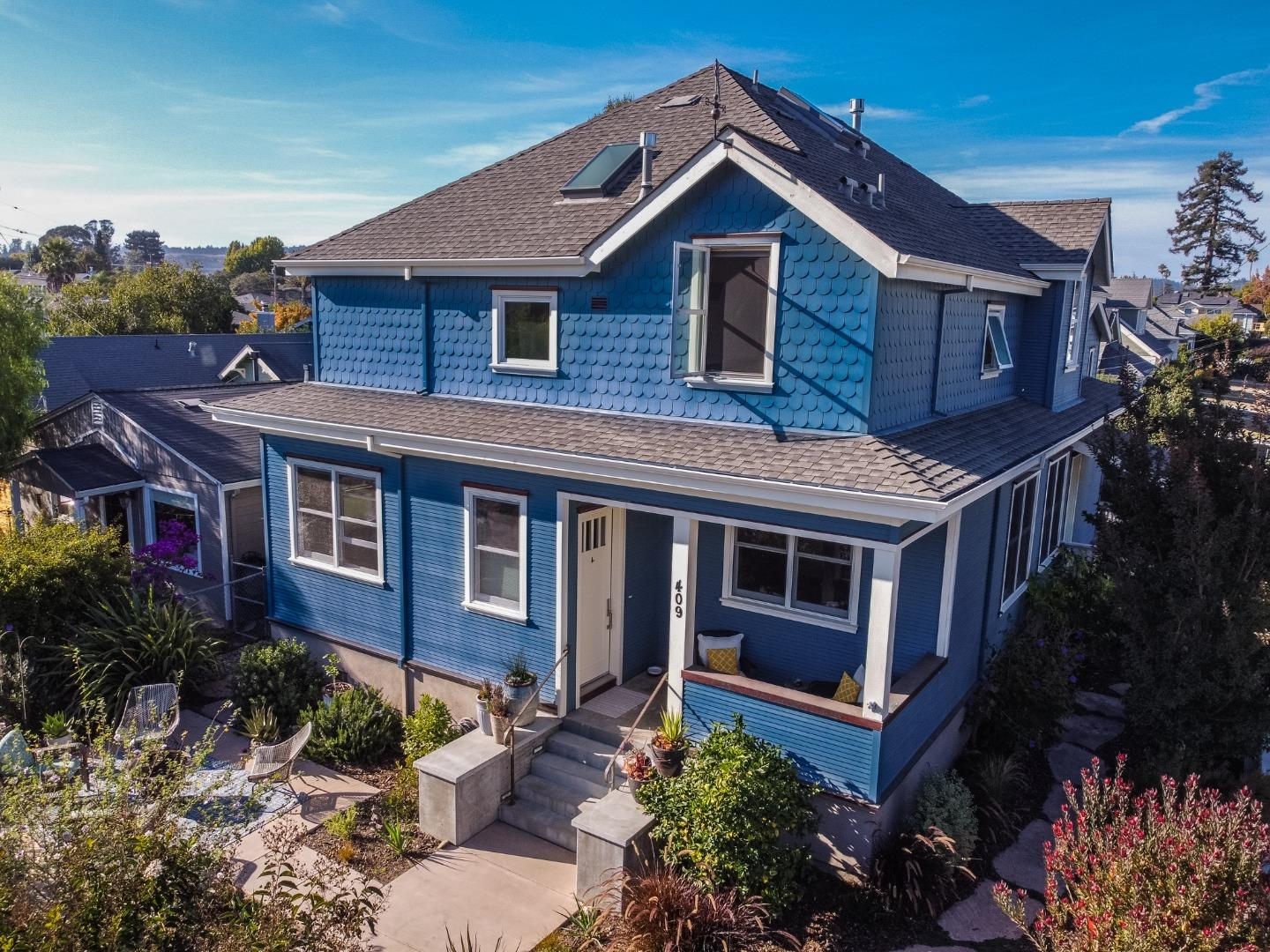 Beautiful 2012 Craftsman-inspired home on a quiet street in beach-going Seabright. Upscale residence features 4Br 4Ba house with 2 master suites and 1Br guest apartment, offering over 3,000 sqft of elegant living space. Main level features open floor plan, high ceilings, oversized windows, hardwood floors. Chef's kitchen boasts Thermador range, pantry, and stainless appliances. Spacious hall leads to master suite w/ marble bathroom & walk-in closet. Completing the level is guest bedroom & full bath. Upstairs features vaulted ceilings, master suite w/ sitting area, marble bathroom, walk-in closet. Extra bedroom, bathroom & large laundry room complete the level.  Enjoy spacious front porch and two patio areas enhanced by fully fenced landscaped yard & stone paths, fruit trees, and raised vegetable beds. A designer apartment above 2-car garage offers infinite possibilities. Only a few blocks from best restaurants, breweries, coffee shops, and a short walk to Yacht Harbor & Castle Beach.