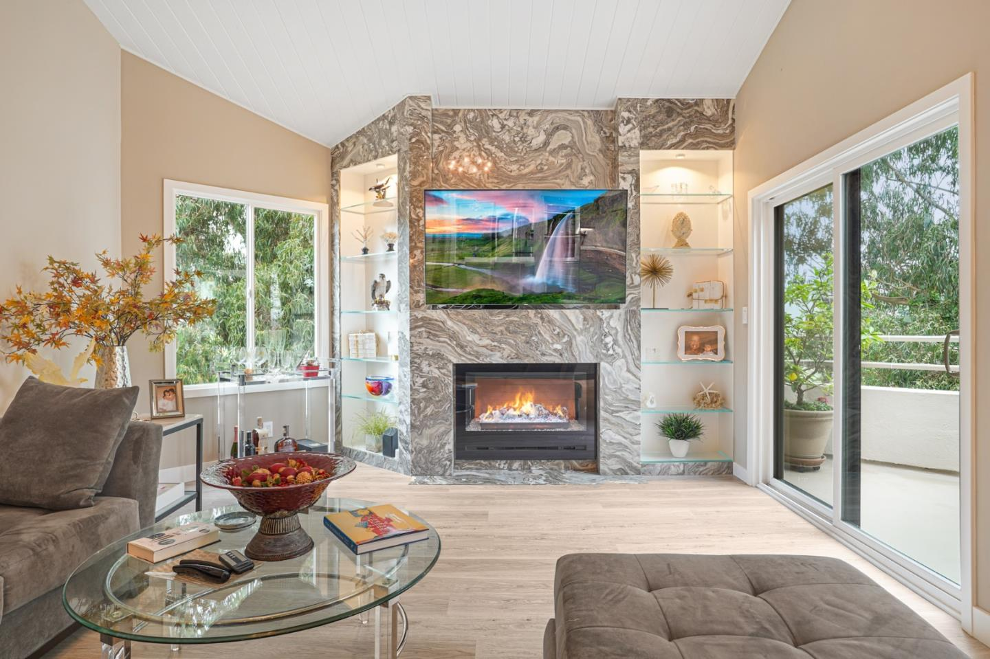 """This stunning totally """"remodeled"""" penthouse style condo has it all! High ceilings tons of sunlight, large windows, custom marble fireplace, hand selected floors all with a touch of modern perfection! No details were sparred in this newly renovated master piece. Dream chef's kitchen with stainless steel appliances and solid countertops and all the best. Showcase european bathrooms with every detail imaginable. Privacy galore magnificient views of SF Golf course and city lights, large veranda for outdoor entertainment and peaceful setting. Located across from Lake Merced, walking distance to shopping and private gated security guarded entry..secure parking, elevator .swimming pool and tennis courts included. No property on market in San Francisco offers this value and quality living at this price. Serious buyers ONLY..."""