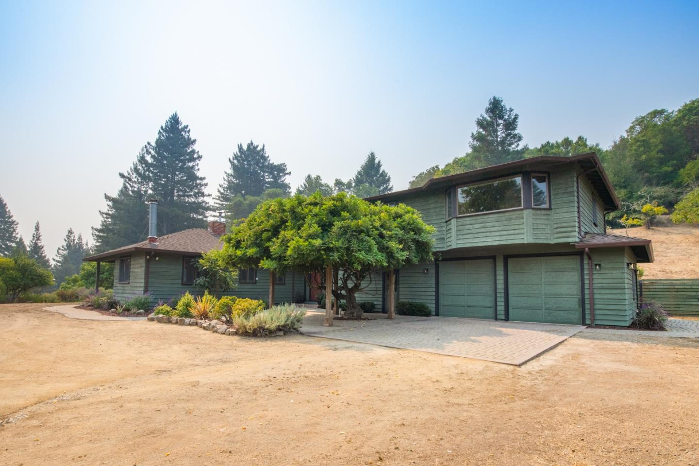 Here is your opportunity to own your very own piece of paradise in the Los Gatos Mountains. This home has been thoughtfully and beautifully upgraded. With new interior and exterior paint, gas cooktop, landscaping, upgrades to the well, exterior lighting and more! This home is sparkling. Nestled on over 6 acres with an abundance of avocado, persimmon, apple, pomegranate and Christmas trees, this land will not disappoint. The 5 bedroom 4 bath home has a large kitchen, formal dining area, bedroom and or office on the first floor and decks overlooking the sunny acreage. The house also has an oversized attached 2 car garage to hold all your toys and vehicles. With almost 2,900 sq ft you will have plenty of space to grow. The land possibilities are endless; farm, vineyards, pool or possible ADU? Great commuter location to both Silicon Valley and Santa Cruz. Come enjoy the best of mountain living at 25505 Soquel San Jose.
