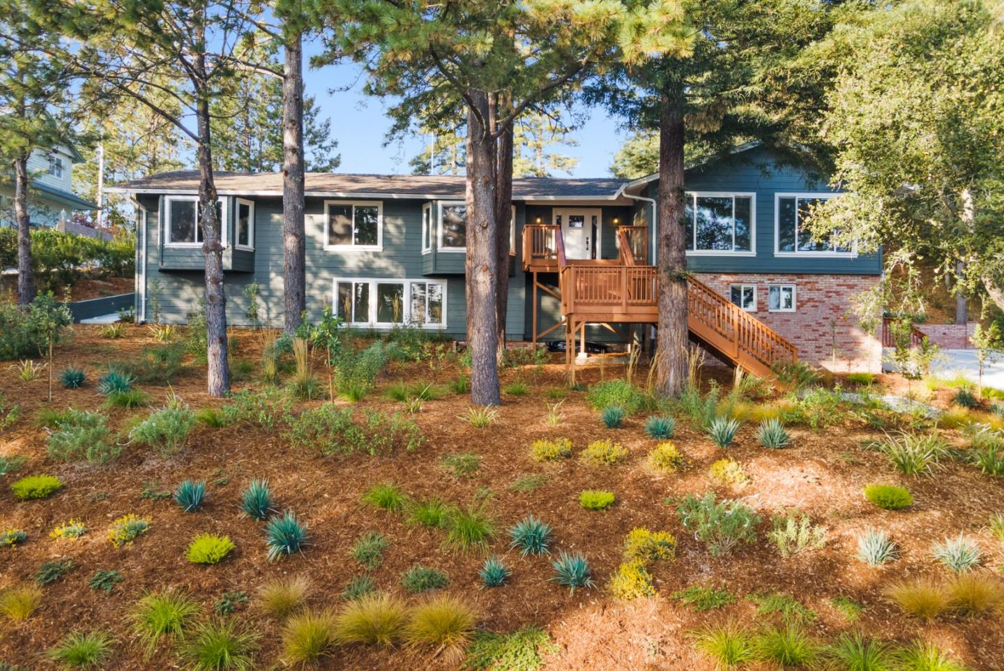 Modern & elegant executive style home in the sought after Hidden Glen neighborhood of Scotts Valley. This stunning 4BR/3BA home with high ceilings & large windows throughout has been transformed in a top to bottom remodel. The kitchen is truly grand, featuring quartz countertops, a huge center island, gas cooktop, double oven, 2 temperature zone double wine, & beverage refrigerator & custom cabinetry. The adjacent dining area has a gas fireplace & sliding doors opening onto the sunny deck & terraced yard. A spacious master bedroom suite features an en-suite bathroom and walk-in closet. The lower level has guest unit potential, with a private entry, full bathroom, & plumbing for a kitchenette. Recent upgrades include new roof, siding, windows, doors, decks, landscaping, irrigation, furnace & water heater. The neighborhood amenities include a pool, tennis courts, playground, picnic tables, horse stables & riding trails. Close to sought after Scotts Valley Schools, local beaches & parks.