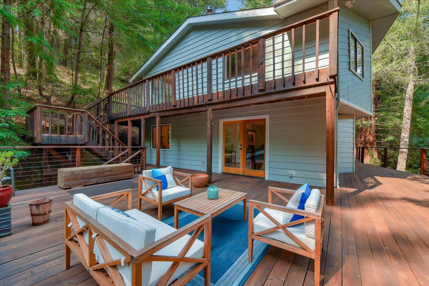 Magnificent Mountains! Spacious is an understatement at 403 Rogers Road. This beautiful mountain chalet sits on over 12 acres of pristine land with hiking trails, hidden flagstone patios, peace, quiet, and complete end of the road privacy. Located in the highly desirable neighborhood at the top of Jarvis Road approximately 15-20 min to Santa Cruz, Los Gatos, Scotts Valley, and Soquel/Capitola. You will love the vaulted open beam ceilings, breathtaking forested views, and seamless flow between indoor and outdoor living spaces. The flexible floor plan accommodates multi-generational living, or those who need extra space for their every day living. With five bedrooms there are an abundance of possibilities for you to customize the space to your heart's desire...home office, gym, studio, hobby space, or long term guest rooms? Shown by appointment only. Please do not drive by. Call for your exclusive tour today. Shown following the covid safety precautions here: https://bit.ly/3h3Ob7o