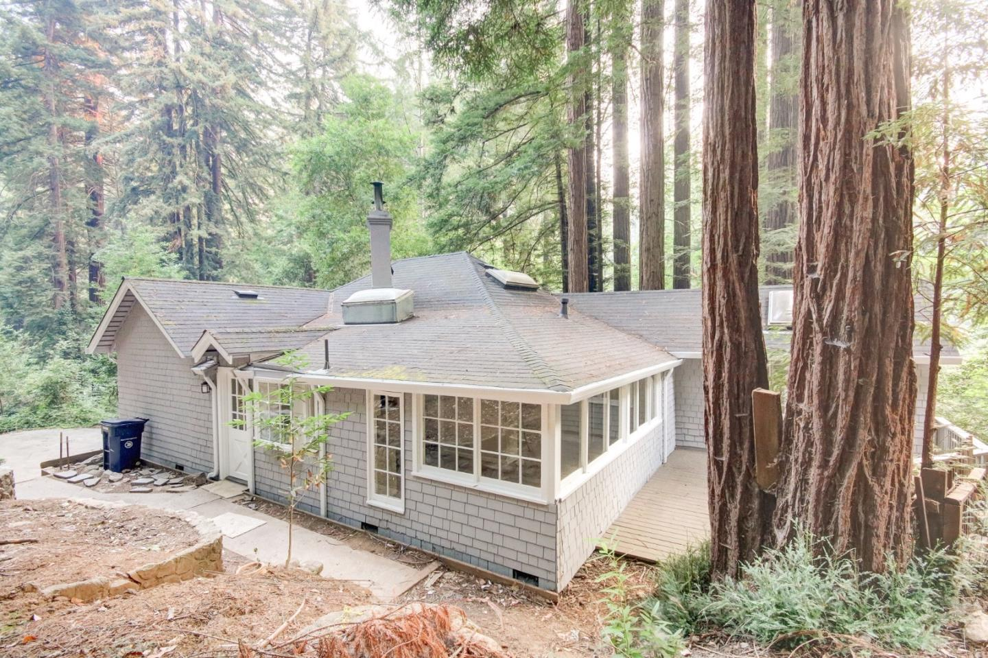 Updated and spacious home behind the Brookdale Lodge!  Loads of light and windows to enjoy the natural beauty of the Redwoods! High/cathedral ceiling in Living room and a wood burning stove. New Kitchen with shaker cabinets, quartz counters and New stainless appliances.  New wood laminate floors, new paint, new carpet, new light and plumbing fixtures! Master with pretty views and Baths are gorgeous and updated! Large basement area, plenty of parking and lovely view deck!  You will love the proximity to the Lodge, restaurants and town, the tasteful updates and the beauty of the redwoods!