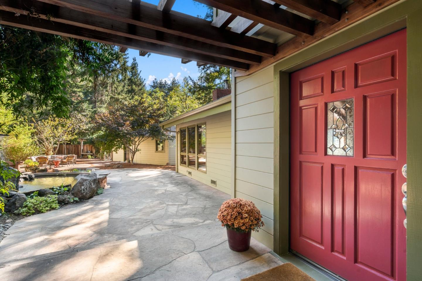 Situated between Scotts Valley & Santa Cruz, this epic home w/ guest house peer into the canopy of the coastal redwoods. Main 3 BR/ 2.5 BA home offers vaulted ceilings, exposed beams, & refinished wood floors. The stylish kitchen with new appliances flanks the dining room with cozy fireplace along with entrance, via spiral staircase, to the cellar below. Gorgeous primary bathroom with dual sink vanity utilizes many windows to capture the stunning perch of the second floor view from the freestanding tub. Separate 1 BR/ 1 BA ADU great for extended family or a private office fit with its own washer/ dryer hookup. A natural courtyard is created featuring stone pathways & tranquil waterfall koi pond. Venture down the terraced steps to the fenced garden area by the creek & follow the drivable dirt road to a red hobby barn fitted with power & ready for projects. Mountain living made easy w/ a quick commute over to Silicon Valley & SJC airport, hiking, mtn biking, & the beaches of Santa Cruz.