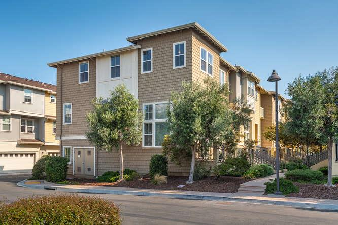"3BR, 2.5BA 1921sf+/-. Welcoming handsome end unit townhome.  Like new. Gleaming hardwood flooring. Floor-to-ceiling, wall-to-wall natural light. Flexible-use first level for a library, formal living room, den, playroom.  The second level features the Great Room, dining, TV, or homework space- an ""all can gather together"" area.  Huge kitchen with center island.  Miles of counter use and a multitude of cabinets.  Convenient half bath on the first level.  Two- car attached garage. Enjoy mountain views and greenbelt trails. Close to Oracle and easy access to Hwy 101 for the commuter.  Lovingly maintained."