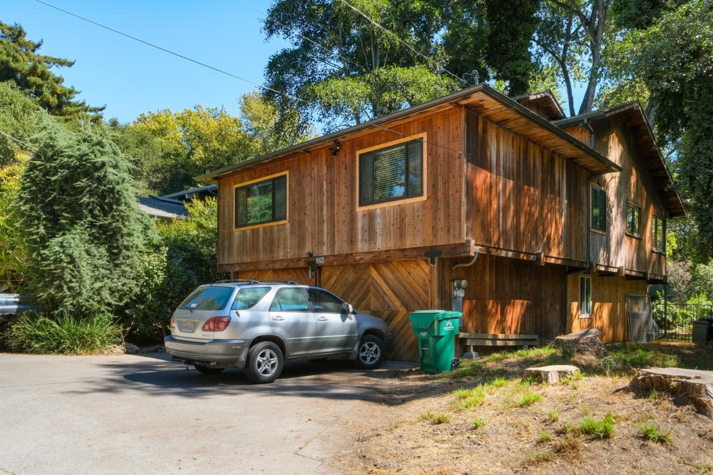"""Imagine looking out windows and seeing nature instead of neighbors in this """"Tahoe-style"""" home perched in a magical creek side setting with a unique in-town location. It's an easy walk to Soquel. Explore nature in your own backyard. The main living is all on one level with an upstairs loft for the artist or entrepreneur. An open and inviting great room design with open beam ceilings, solid wood beam construction and finishes in cedar, fir, redwood, and oak. Hardwood floors throughout, Updated Mather bath with walk-in shower, updated hall bath with walk-in rain shower, well placed windows for catching the views, a nice deck overlooking the yard, and 2 car garage. Capitola Beach sits a mile away and Old San Jose Rd makes it convenient for commuters."""