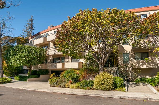 This lovely, updated 2 brd, 2 ba condo faces a tree -lined street a few blocks from Hillsborough, Burlingame Ave, & Burlingame train station. Its sunny open floor plan & 3 skylights provides an inviting ambience & space for entertaining or relaxing at home. An eat-in kit showcases the beautiful new quartz countertops, stainless-steel appliances, & engineered wood floor. Spacious living & dining rooms have fresh paint, new carpeting & lighting, & a fireplace. A sliding glass door in din room overlooks lush treetops & opens onto a balcony. The huge master bedroom has its own balcony, new carpeting & lighting. A master bath includes a generous vanity, stall shower, tile floor, & skylight. The second bedroom also has a balcony, new carpeting & lighting. The hall bath has a shower over tub, gray vanity, granite countertop, & skylight. The in-unit washer and dryer are in the hall with a new tile floor. There is 1 assigned and 1 unassigned parking space & additional storage.