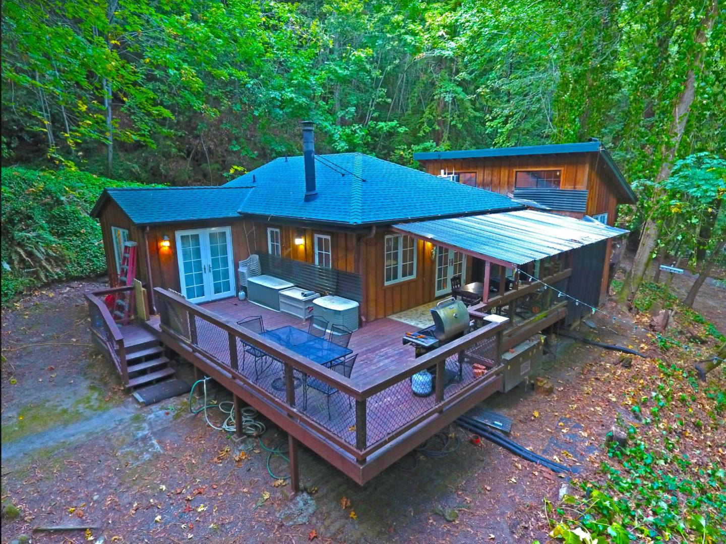 Quality Craftsman Creekside Abode, situated on a magical woodland setting, just 4.5 miles from the Corralitos Market accessed by 2-lane paved road the whole way there. This beautifully constructed home features modern kitchen, vaulted open beam ceilings and high-grade vertical grain Doug fir and redwood components throughout. Accessed by a footbridge over Corralitos Creek to transport you to an enchanting environment of tranquility. Includes water rights to the creek plus a functioning Artesian well, with storage tank. Vehicle access is via seasonal creek crossing 11 months out of the year, with daily access via footbridge that crosses the creek from the parking area on Eureka Canyon. A very special property tucked away in the hills!
