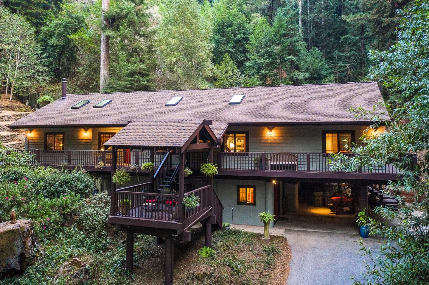 Updated home on quiet private parcel.Picturesque setting, beauty of towering redwoods+bright sunlight.Gorgeous living rm w/vaulted ceilings dramatic fireplace, hardwood floors, custom windows throughout.Updated kitchen has Corian countertops,new glass tile backsplash,stainless steel appliances,& large pantry w/custom Shoji door.Master bedroom w/updated master bath,sitting area,walk-through closet w/5'x12' finished attic for storage or other use.2 add.bedrms offer lrg lofts.child/teenage paradise.Bonus room,accessed from carport for 4th bedroom or whatever. Outdoor area has expansive deck, kitchen area w/sink, extensive cabinets, countertops,hot tub,outdoor lighting & built-in benches.New exterior paint, plenty of parking recreational vehicles,2-car carport,extra parking.Great location w/access from Soquel-San Jose Road,Branciforte Hwy 17.Approx.10 mins(5.9 miles) to Soquel Village,just a bit further to beaches. 3.5mi to Hyw17,10 mins to Scotts Valley.