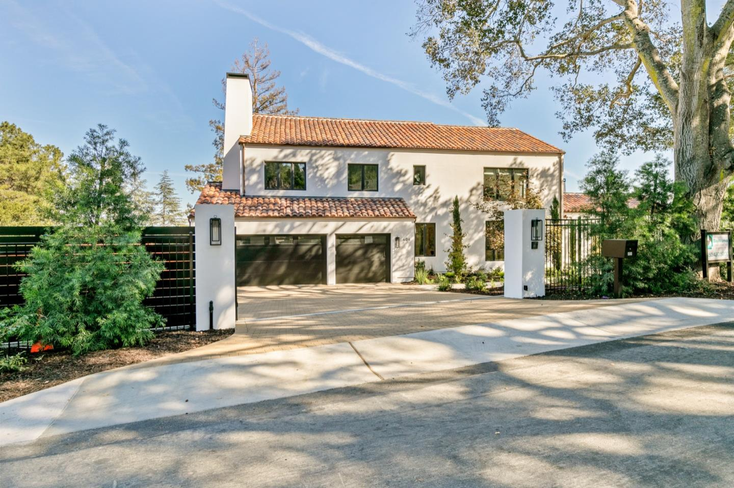 Entirely renovated and expanded, this just-completed whole-home transformation is a picture of chic modern luxury with a nod to its circa 1926 Mediterranean heritage. Set on approximately three-quarter acres beyond dual pedestrian gates for added privacy, the home opens to a palette of soft white walls, mid-tone white oak floors, and designer brushed gold fixtures and lighting, along with an exceptional array of marbles and Italian tiles.Five en suite bedrooms are arranged on the upper and lower levels easily accommodating a variety of lifestyle needs, plus there is a detached one-bedroom, one bath guest house with full kitchen, which doubles for poolside entertaining. Adding to the appeal is a dedicated office, a tremendous recreation room, a fitness center, plus a fully customized wine cellar. Remarkable in its beauty and incredible livability in a sought-after premier location midway between San Francisco and Silicon Valley this is the ultimate family or executive retreat