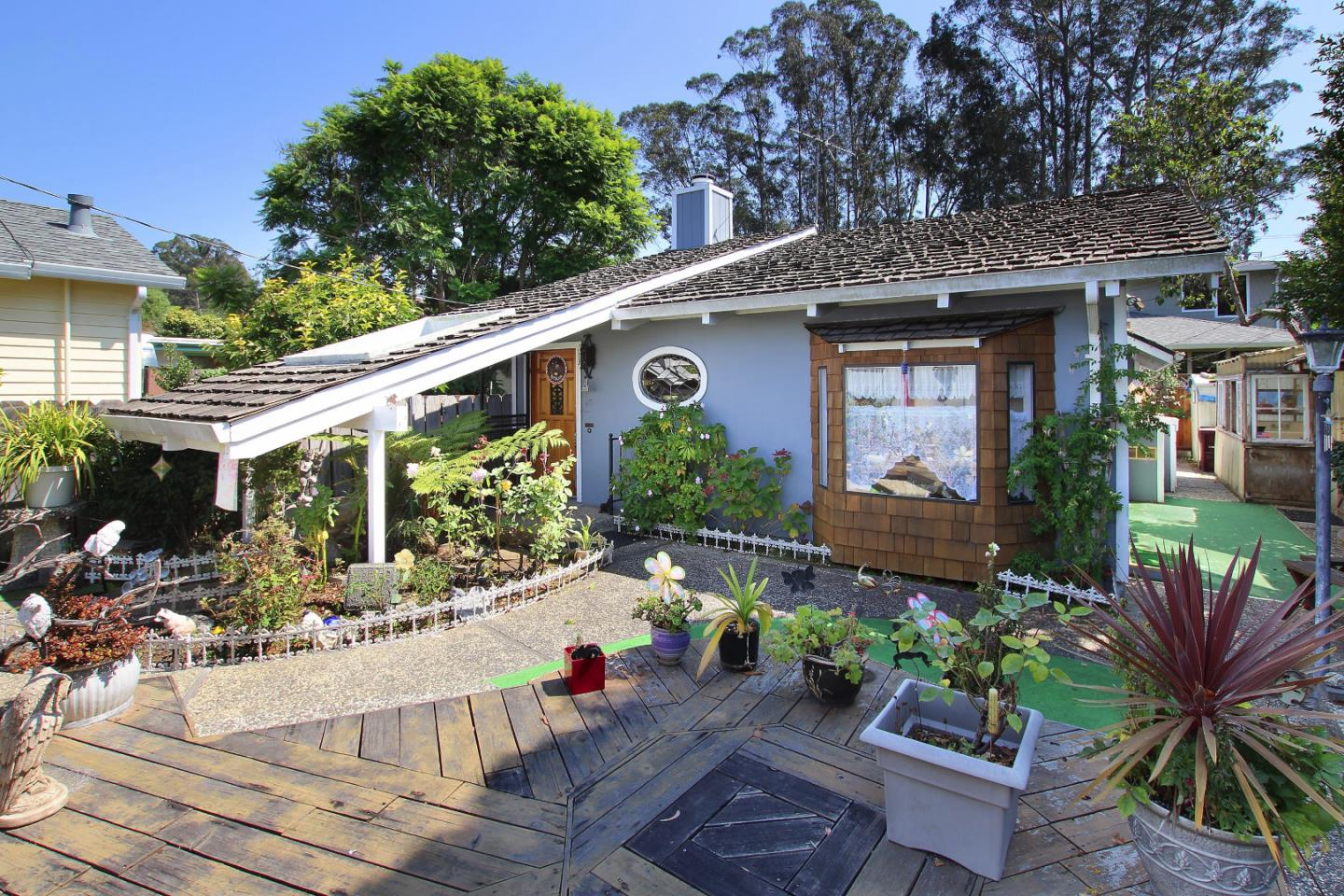Opportunity to be in  a great Capitola Location! Adjacent to Depot Hill this bungalow has privacy and ample parking with a 3-car garage. Take a walk in your private rose garden courtyard to a darling house. Property is in original condition. Living Room has wood vaulted ceilings with a fireplace. 1 bedroom with cozy fireplace + bonus room.There is a green house on the property as well. You are just around the corner from walking to Capitola Village and beach, New Brighton State Beach, Gayles Bakery and Capitola Produce. Small park setting across the street.
