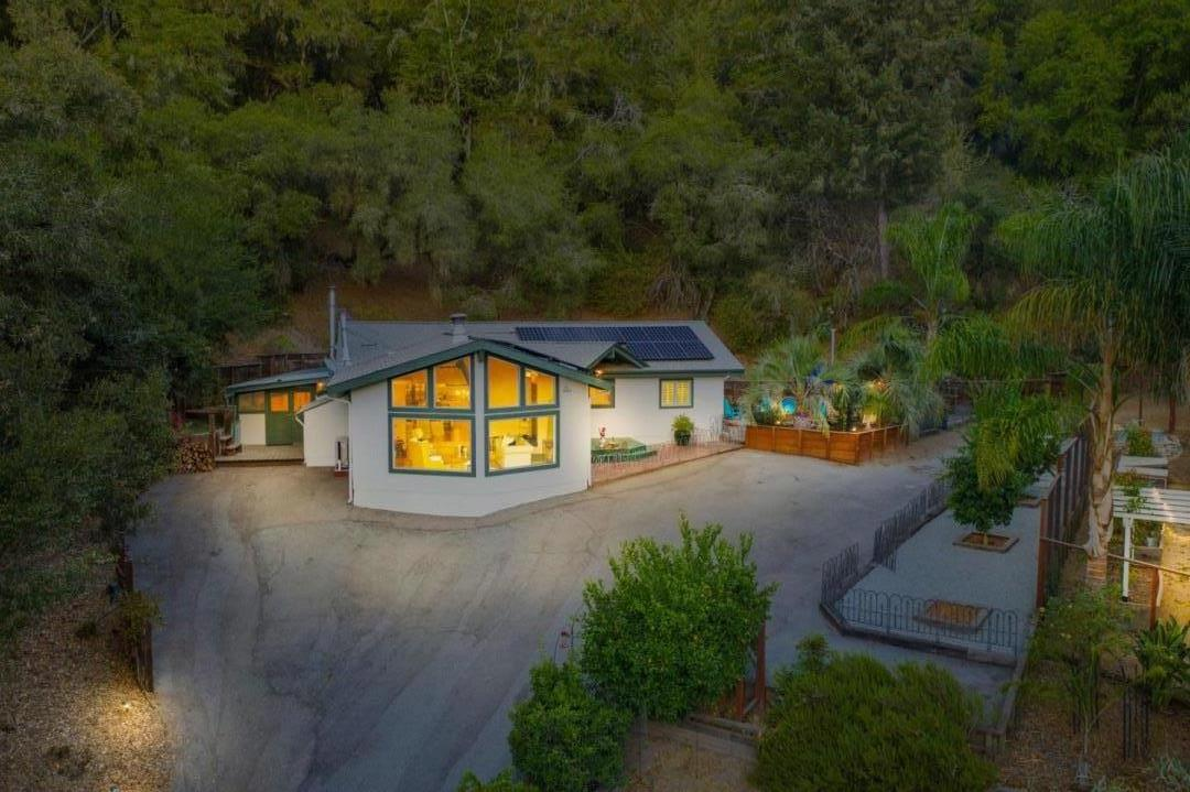 Tranquil setting on a private road that leads up to this beautiful property, a few short minutes from town. Gourmet kitchen a must see. Gorgeous granite & stainless steel countertops, enormous island & an abundance of storage w/ solid maple cabinets, vaulted ceilings & skylights. Feast your eyes on the indoor brick pizza oven & double pantry. French doors lead to the screened dining porch. Picturesque windows in the living room offer a view of rolling meadows & beautiful sunsets.  Wander through the spectacular garden with brick path, rose-covered arches, mature citrus trees, gazebo & raised beds surround you, an outdoor lovers dream with rainwater storage. This property offers all the benefits of a country farmstead in Scotts Valley with the easiest commute to Silicon Valley. The Solar is owned & has a Tesla II power wall, 2 parcels with the possibility of adding a second home.  Enjoy being self-sufficient.