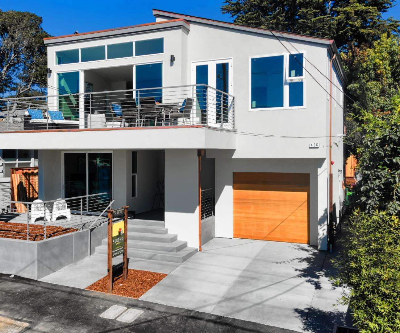 """Brand New Construction!!!  Features include: Tile floors throughout with 6 different zone-radiant heating, All Wolf appliances, Sub Zero refrigerator, quartz countertops throughout,  Ocean views from 1st & 2nd floors, oversized 1 car garage with 12 foot ceilings- pre wired for 220 electric car charging, copper downspouts.  Short walk to """"beach gate"""" path leading down to Seacliff State Beach, restaurants, shops, coffee."""