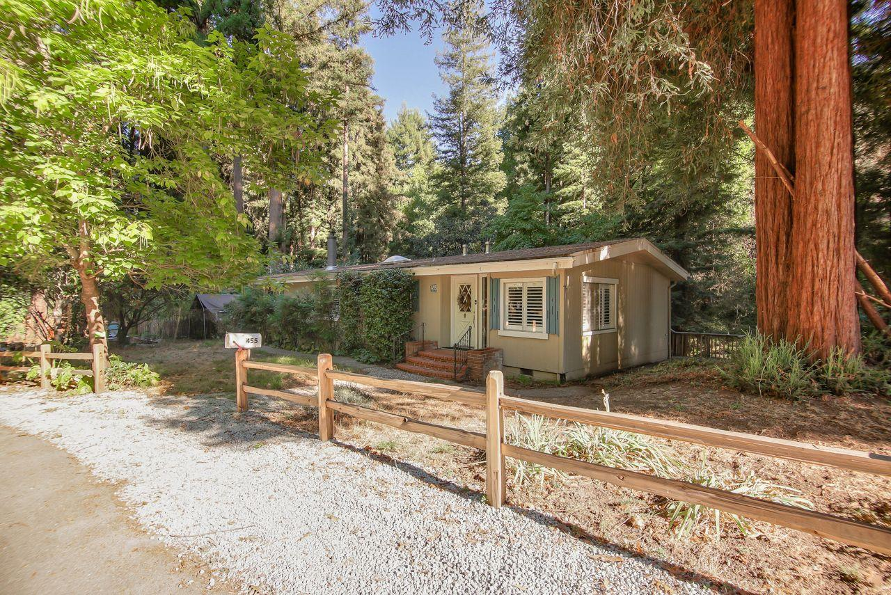 Magical property located in the heart of Felton near Henry Cowell State Park!  Single level home with 2 bedrooms and 2 full bathrooms + laundry/utility room.  The charming dining area with brick gas fireplace is a great place to have your morning coffee or a Zoom meeting.  The kitchen features a breakfast bar, gas stovetop and skylight.  The outdoor space is amazing and so unique!  The property includes Shingle Creek and has multiple outdoor areas to enjoy.  Try your hand at the frisbee golf net, have lunch on the picnic table by the stream and listen to the birds from your back deck.  The detached 2 car garage offers plenty of parking and storage and there is a bonus room behind the garage.  Located just minutes from the beautiful Henry Cowell Redwoods State Park, Roaring Camp and downtown Felton's restaurants and shopping.  Welcome home!