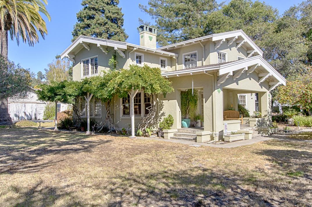 This craftsman foursquare is part of a unique 3 legal parcel configuration that has its roots in Santa Cruz history. Two-story home, built in 1917 of old growth redwood, 3 bedrooms, 2.5 baths; the adjacent lot has a newer oversized 2-car garage with a loft that is used as an office; and the third lot contains the original carriage house/barn with room for multiple vehicles, art studio, exercise room and more. Hardwood floors and beautifully crafted built-in cabinetry, custom wood fireplace, crown molding that continues into a formal dining room with wood wainscoting. Updated kitchen with breakfast nook, high ceilings with crown molding. Pride of ownership is evidenced by the many original architectural details and fixtures, along with modernization and complimentary updates throughout the home. Mature trees and landscaping, this corner lot combination, which includes alley access, creates a private enclave in the city limits.