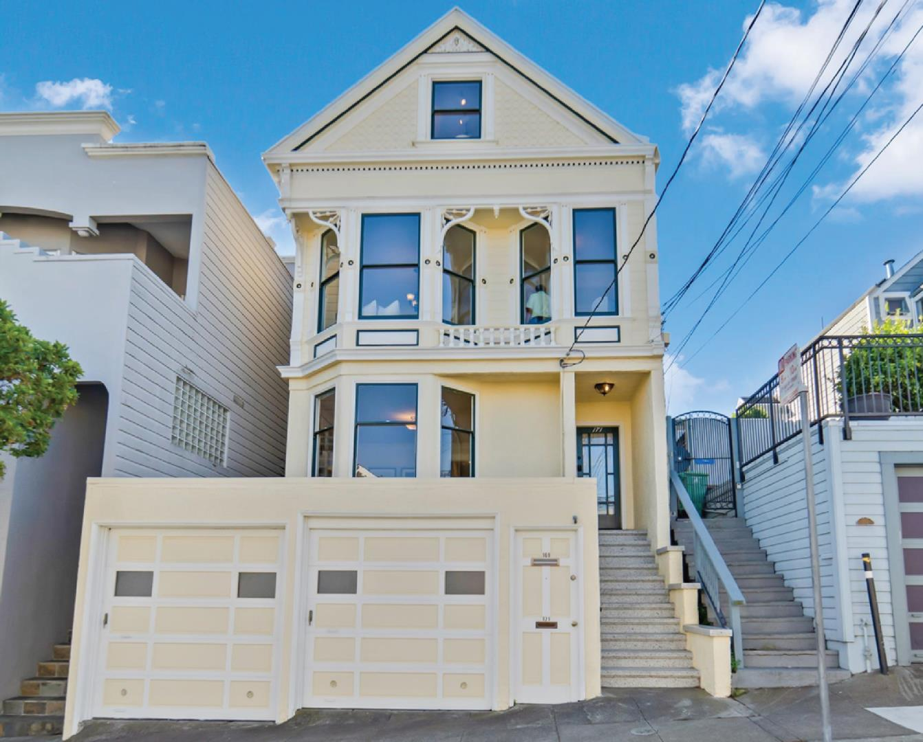 With $250K in upgrades, 169-171 Randall Street is an elegant Victorian duplex featuring a spacious, 3BR/2BA upper unit, a desirable 2BR/1BA lower unit, total 3,060 sf, and 2-car garage. The upper unit, with gorgeous panoramic view of downtown San Francisco, includes an inviting living space with soaring ceilings, abundant natural light, skylights, recessed lighting, refinished bathrooms and kitchen (granite countertops), and modern appliances (including washer/dryer). A sun-filled family room opens to a rebuilt deck and backyard garden with fruit trees and a 300 sf shed. The lower unit has a large living room, eat-in kitchen, and its own laundry room. The house is in Fairmount Heights, blocks from MUNI buses and light rail and corporate shuttle stops, restaurants, coffee shops, and markets. Larger shopping districts are within a mile. Nearby Upper Noe Recreation Center and Glen Canyon Recreation Area offer outdoor fun with kid-friendly facilities. BART and I-280 are readily accessible.