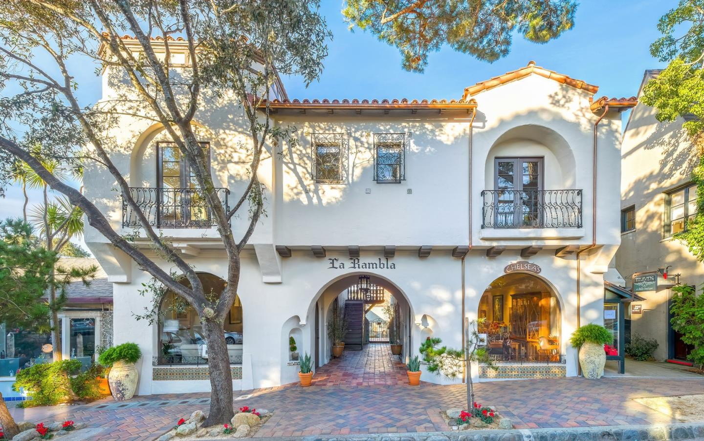 One of a kind luxury property in the heart of downtown Carmel-by-the-Sea featuring two residences with ocean views, a private and sunny 1,700 sf courtyard with designer lighting and sound, plus two commercial units with hardwood floors and separate baths. Located just a few blocks from world-renowned Carmel Beach, this Mediterranean-style building, originally constructed in 1929 and designed by Guy O. Koepp, recently underwent a multiyear, extensive renovation. Highlights include high-end finishes throughout, elevator, laundry room, 3 storage rooms, plus a reception room in close proximity to the courtyard. This trophy property offers a variety of uses and possibilities. Property is deemed historic and could offer a tax benefit to its future owner. Seize your opportunity now to own an iconic piece of our village by the sea.
