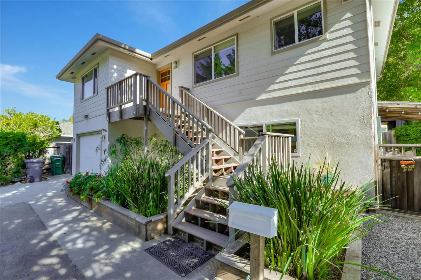 Great investment value located in a beautiful neighborhood 5 minutes from the freeway, 10 minutes from the beach and 20 minutes from San Jose. Scotts Valley schools are some of the best in the area. This solar 4 bedroom 2 bath home was updated 9 years ago with an option for two separate living areas.  Enter this bright, open home and glide over hardwood and tile floors to a gourmet kitchen or lovely gathering room with fireplace. Treetop views via double paned windows. Ample parking, generous lot with a spacious garden. Generous storage in bedroom closets, hall and bath closets, attic and rear of home.