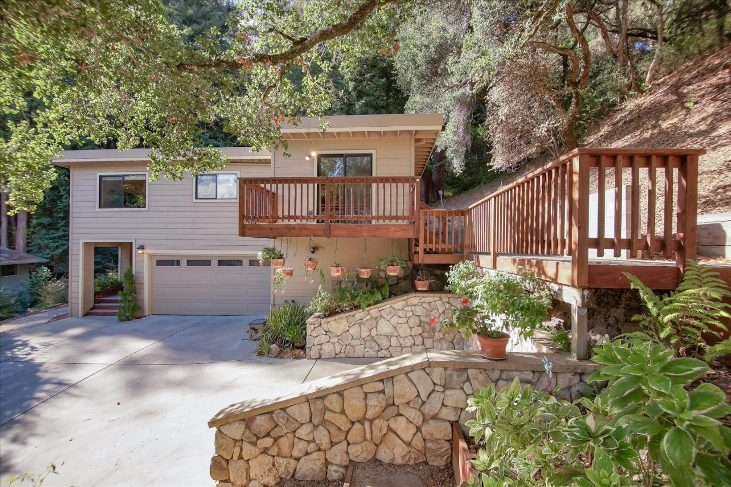 Move-in ready, this home is a beautiful split level family home with amazing updates surrounded by redwoods and oaks. Warm wood finishes combined with high ceilings and lots of windows for natural light. Located in the center of Scotts Valley, yet feels like you are in the country. This house is perfect for entertaining with an open floor plan consisting of two living rooms, a large kitchen with custom cabinets granite counters and high end appliances. A bonus room that has a 1/2 bath, can be used as an office, gym, or guest room. Lots of possibilities with this beautiful home! Take a step outside enjoy the amazing yard.