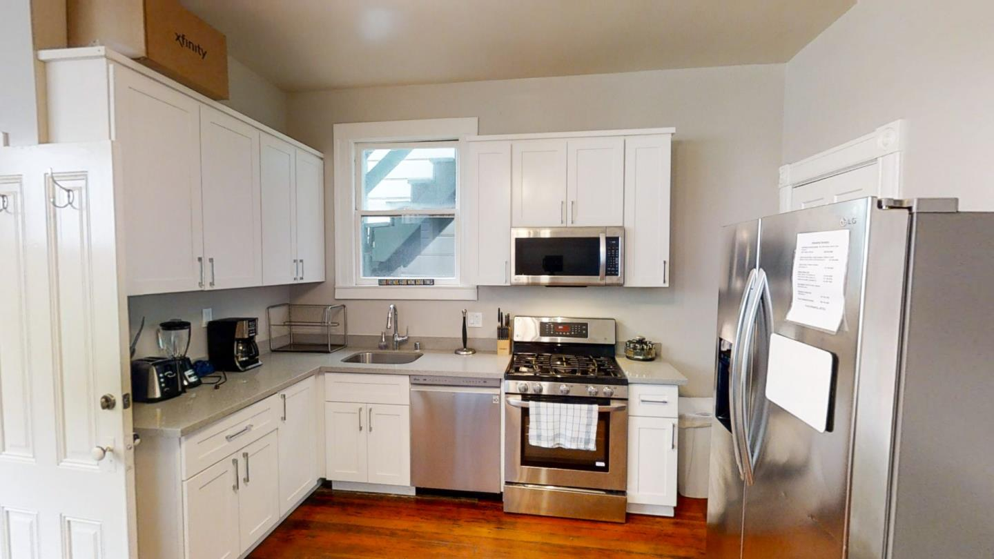 The living area is spacious and bright with polished hardwood floors and chic suspended lighting. Its nice kitchen is equipped with fine white-painted cabinetry with ample storage space, smooth granite countertops, a refrigerator, oven/range, dishwasher, garbage disposal, and microwave. The washer and dryer are in the unit along with electric heaters (2 in the bedroom and 1 in the living room). One of the comfy bedrooms has a built-in closet. The lovely bathroom is furnished with an enclosed shower and vanity sink cabinet surmounted by a framed mirror.  Pet-friendly home with a $500 pet deposit/pet. No smoking, sorry. The exterior has a fenced yard. It comes with on-street parking and tenants must secure a permit, $125/year. Water, gas, electricity, cable, Internet and sewage will be the responsibility of the tenant. The landlord will cover Trash. Utility service providers: PG&E and the San Francisco Water Department.