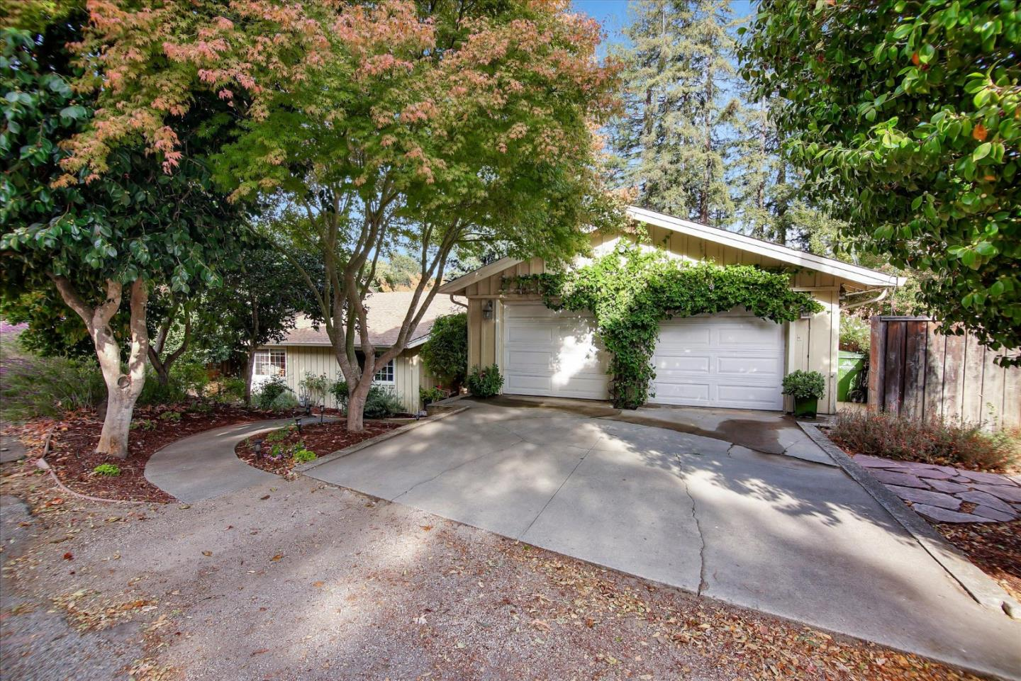 This Beautiful home sits on a large landscaped lot in a great Scotts Valley neighborhood. At almost 2,100 sq.ft. this property is close to the best schools, restaurants, shopping and the commute. The main level of the home boasts a remodeled kitchen with breakfast nook, a large family room with wood burning stove, 3 bedrooms and an office/den. Upstairs you will find a bonus bedroom/game room that isn't included in the square footage. The family room leads out to an entertainers backyard. Custom landscaping, redwood deck, patio with firepit and large side yard for storage are just the beginning.  This property also features a finished basement for extra storage or your wine collection.