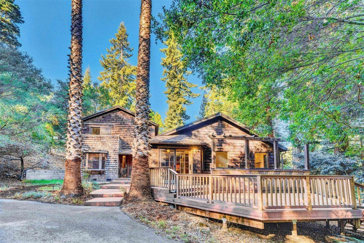Contemporary Redwood Home nestled in popular Day Valley, this classic 4 bedroom, 3 bath home is move-in ready.  The almost 2000 square feet of living space features 3 large bedrooms, two bathrooms,  living room, and eat-in kitchen and dining on the main level. Upstairs is dedicated to the exclusive primary suite with balcony, walk-in closet, and beautifully updated bathroom. Gleaming hardwood and tile floors throughout, with other tasteful wood tones and features. This home is hardwired for high speed internet and home security system, ready for all your devices and modern lifestyle. Awesome newer trex-type deck in the front, with outdoor bar kitchen and sliding door to dining room. This property has large front and back yards, plus more usable land on 1.5 acres. Plenty of space for an ADU or guest house. Great parking and storage with a detached 2 car garage. This property is only minutes away from hiking, beaches, schools, and shopping. This fantastic house wont last long!