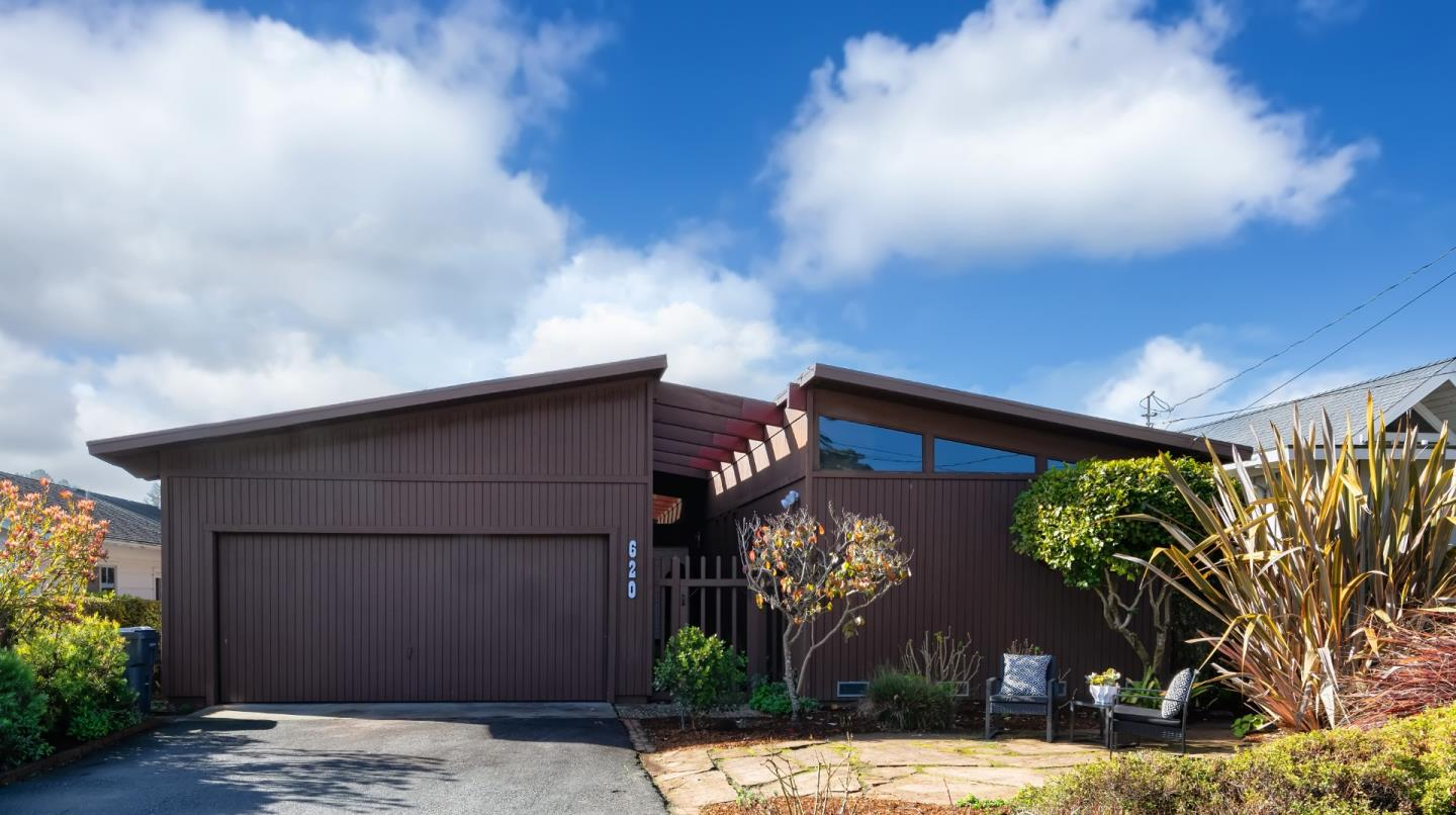 """Single level beach house in Rio del Mar's most desired """"Cliff Drive"""" neighborhood close to Hidden Beach Park and the miles of white sand beaches that make Rio del Mar famous. Retro Mid-Century Modern design with an open floorplan, high vaulted ceilings, cozy fireplace and breakfast bar. Great indoor outdoor flow for entertaining in the sundrenched yard. Enjoy stroll's to the beach, nearby Seascape Golf Course, shopping and restaurants. Live the beach lifestyle, Rio Style!"""