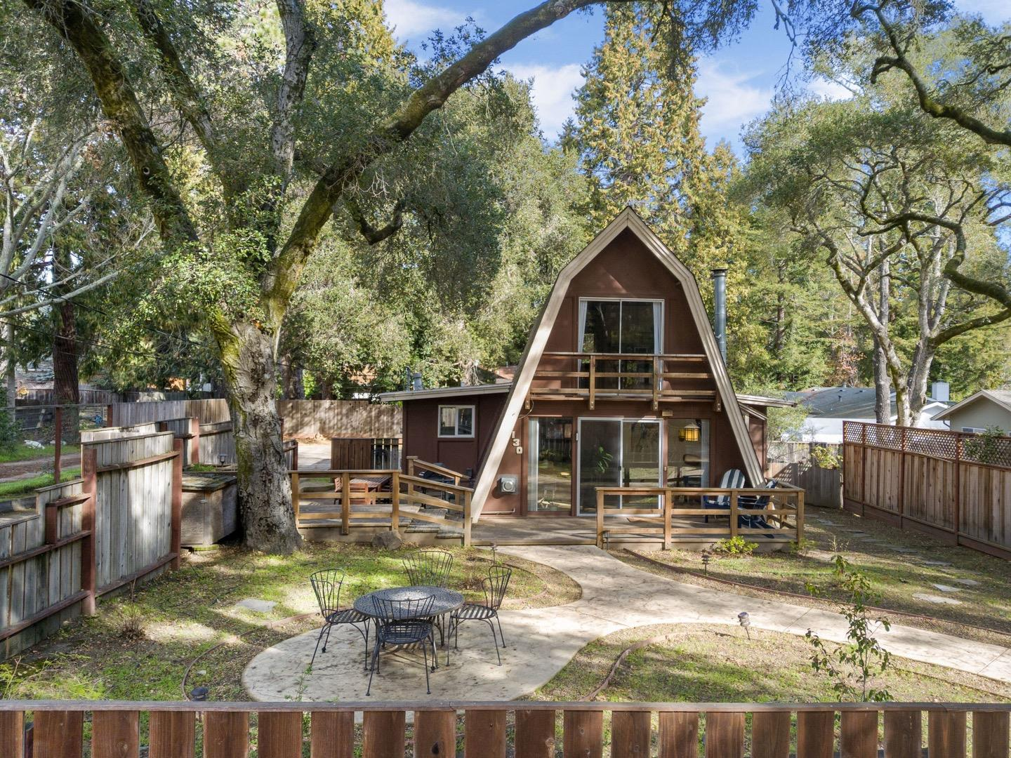 This unique A-frame home is as good as it gets. Set on a quiet, tree-lined street, this adorable starter home features two master suites, an open floor plan with exposed wood beam ceilings, and a cozy, wood-burning stove. There is an upstairs loft area, currently set up as a den with a daybed for guests. Perfectly situated, this home has mountain biking and hiking trails at its doorstep and access to some of the best beaches in the state.  An extra long driveway is perfect for parking oversized vehicles. Easy commute to San Francisco or the Bay Area. Highly walkable neighborhood near Scotts Valley grocery stores, coffee shops, restaurants, and parks. The house sits nestled among heritage oak trees on a level and fenced lot. In addition to the sunny front porch, there is a side-patio with a BBQ and lounge area, and a landscaped front yard with a fire-pit and raised planter boxes. The detached garage is semi-finished and makes a great exercise and workshop space.