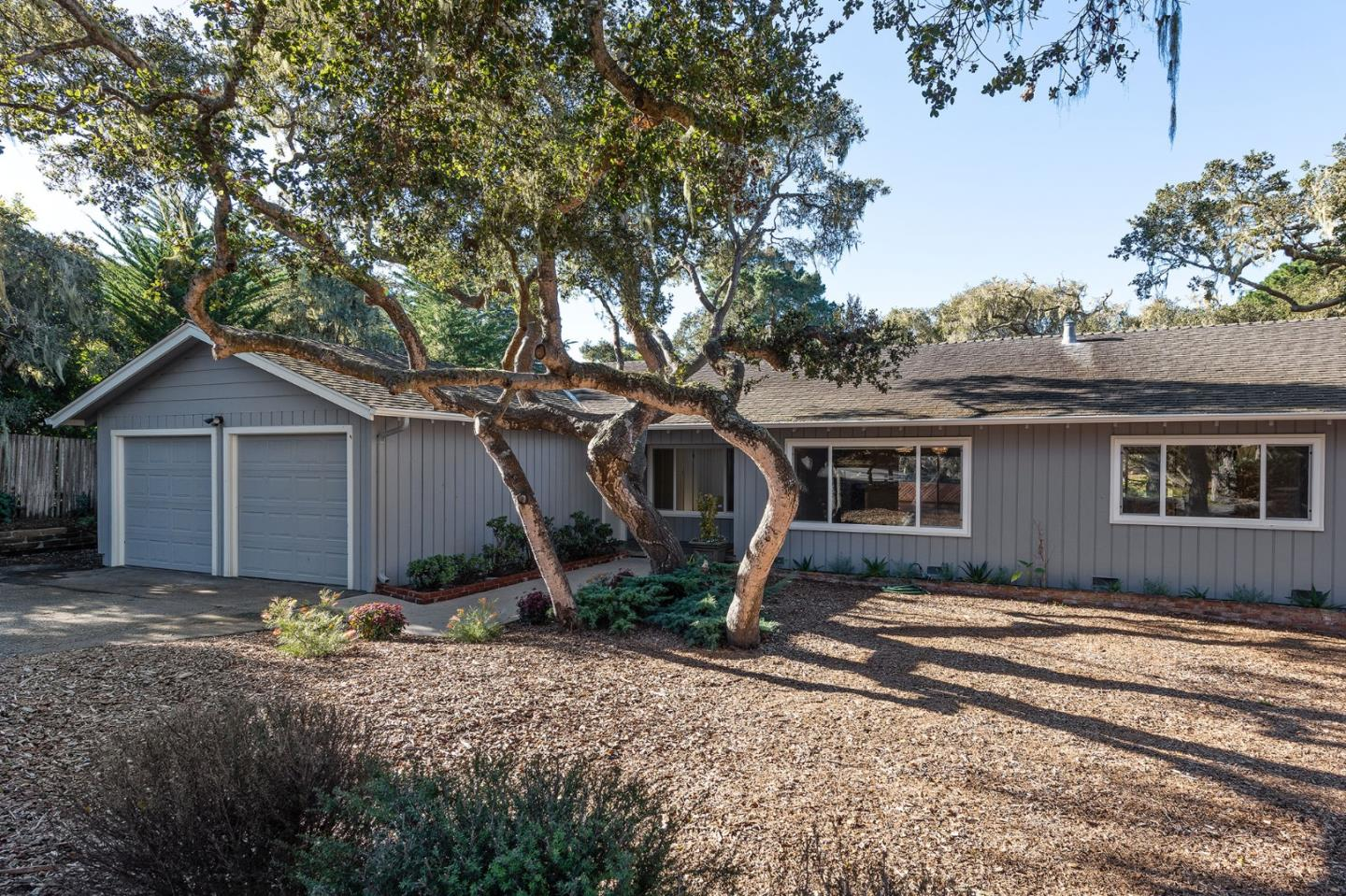 This single level home is the perfect weekend home or full-time residence in the Country Club area of Pebble Beach. Move-in ready for you to settle in and begin enjoying the coastal lifestyle where you can walk along the seaside and forest pathways. This home sits on a corner lot just blocks to Spanish Bay. It features four bedrooms with two full baths and one half-bath. The large open living room with fireplace and built-in bookshelf welcomes you home to a cozy space and is equally inviting for entertaining guests. There is a dining room off of the kitchen and a separate laundry room. The fourth bedroom is on this side of the house makes it perfect for a separate guest room or home office. Recently refreshed, the home has a comfortable floorplan today but you can envision the opportunity for more future improvements.