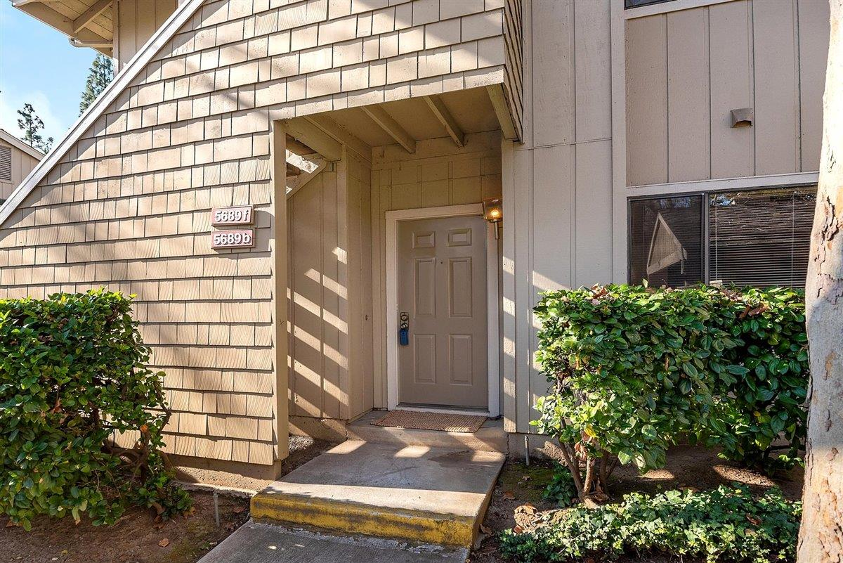 Light and bright ground floor end unit with generous private patio, ideal for enjoying gentle Spring days. The inviting living room boasts a cozy fireplace and adjoins the dining area with breakfast bar.  Well maintained, the gracious home includes a large master suite and indoor laundry with extra storage in the utility room. Immediately outside your door in covered parking and guest parking for visitors.  The community includes a swimming pool, spa and parks, and is close to shopping and restaurants. Easy commute location yet tucked away in a quiet neighborhood, this home is ideal for first time buyers or investors.   Schedule your private tour today.