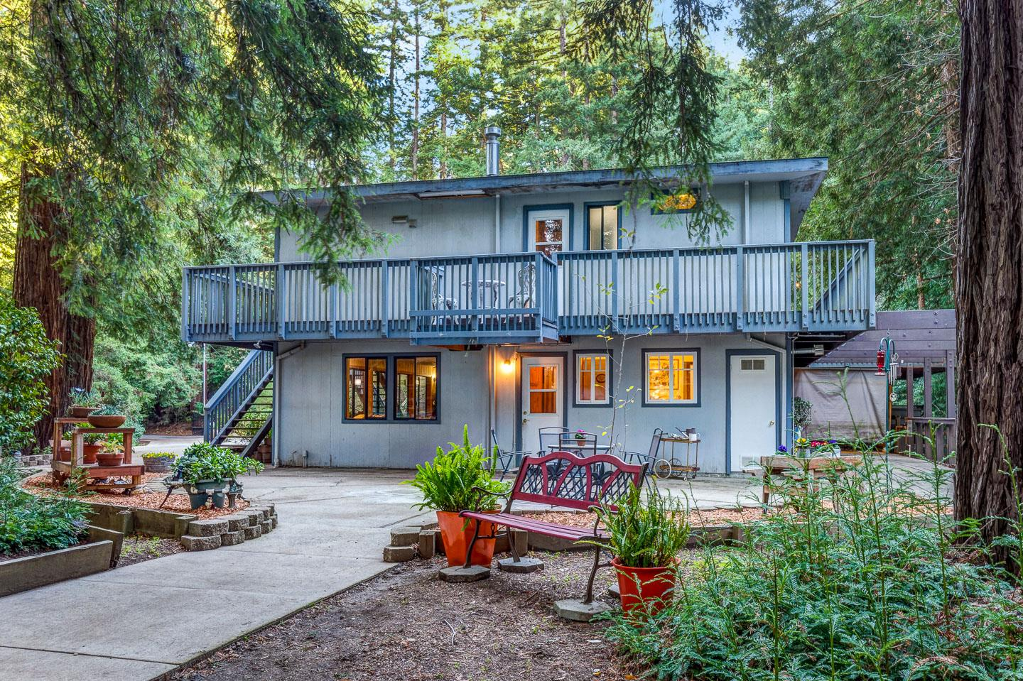 Nestled in the Santa Cruz Mountains, this one-of-a kind-home on 3 acres offers complete privacy. Ample windows maximize views of the majestic redwoods and natural surroundings.  Large wrap around deck to enjoy the fresh mountain air and fabulous night sky. Floorplan features 1152 SF upstairs with a large living room, dining area, kitchen, two bedrooms, full bathroom, and large pantry! Downstairs includes 1152 SF with a large family room with a cozy free-standing gas stove, office area, master bedroom w/ large walk-in closet, a full bathroom,  and laundry nook.  Storage abounds!   Perfect for a work-at-home or a multi-generational buyer!  Large workshop, two car-carport, storage shed, potting shed, jacuzzi and children's play yard. Private well with three storage tanks. Deer fenced with a lovely entry gate. Plenty of sun to grow vegetables in the summer!  Loads of paved parking. Close to town, yet private.  Easy access to Highway 17.  10 minutes to Los Gatos, 12 minutes to Santa Cruz.