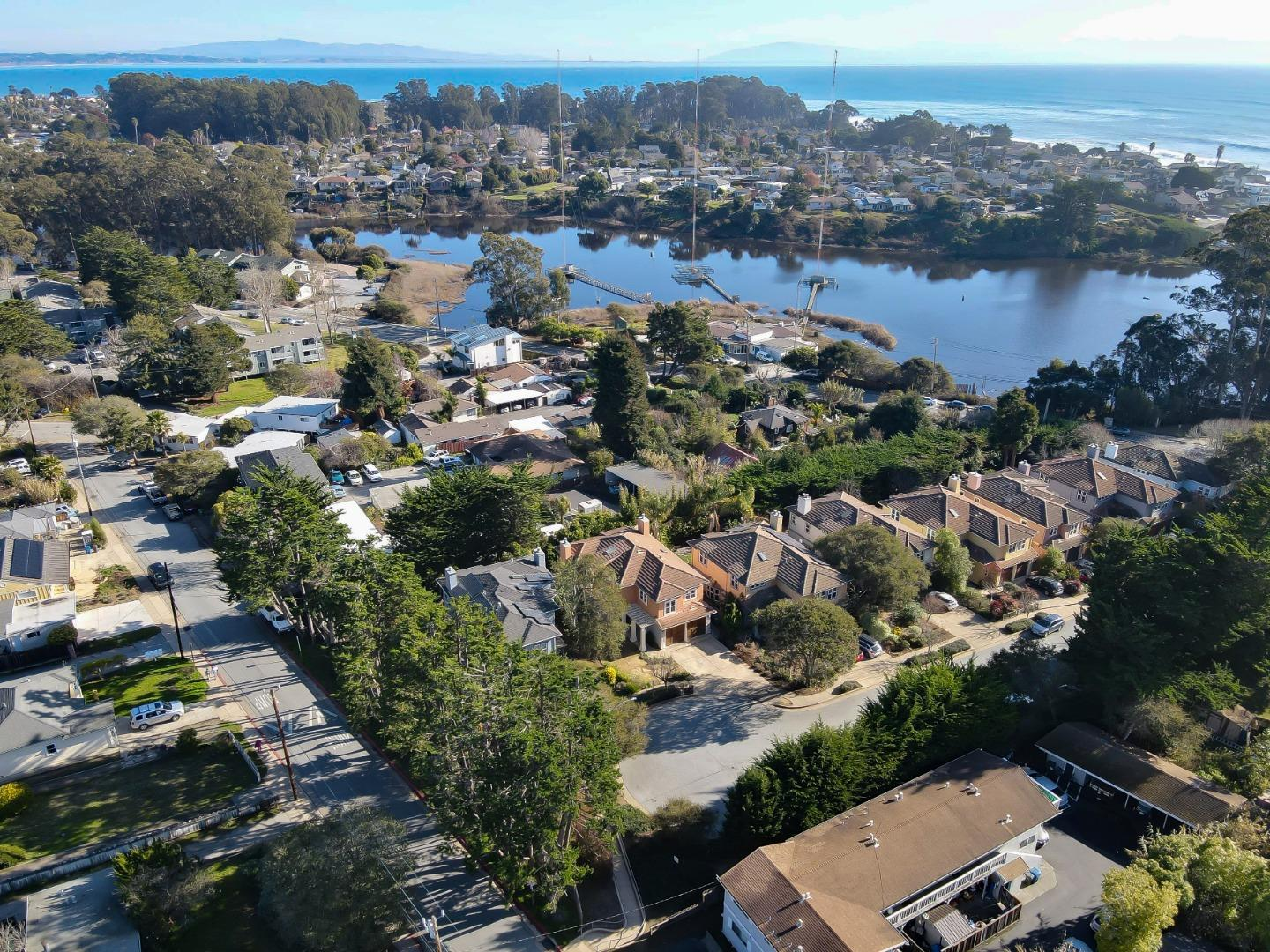 Like-New Beach Home! Just a 3 minute walk to beach and surf on the Corcoran Lagoon path, this well-built home with open kitchen-living area features all-new kitchen with Granite island, full wall glass tile backsplash plus all-new custom kitchen cabinets and upscale appliances including subzero fridge. And don't miss the large walk-in pantry and separate walk-in wine closet! The open living dining area with fireplace is open yet cozy with double French Doors and windows opening to a private rear yard finished with pavers and a hot tub. A sweeping hardwood stairway with large, usable landing area opens to the Master Suite with vaulted ceilings, walk-in closet and gas fireplace. The bath has an oversized tub, and walk-in marble shower. There are two more bedrooms and a full bath upstairs plus separate laundry. And a two car garage too!  All conveniently located on a private cul-de-sac in easy walking or biking distance to Starbucks, restaurants and other great beach getaways. Come enjoy.