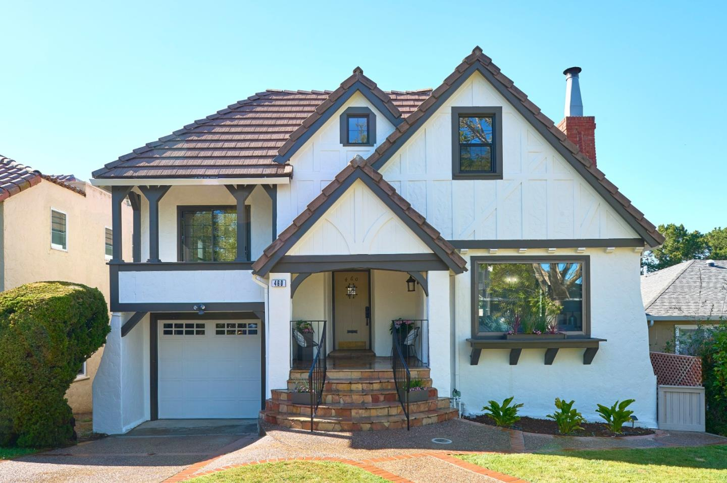 This Gorgeous Modern Tudor style home has a HUGE usable yard on a Quiet street adjacent to Central Park/playground and currently reconstructing Amazing New Community Center.  With multiple levels, it's ideal for those with a large growing family and for those of us still working from home with private offices for your Zoom meetings.  Current owners fully permitted the downstairs family room with two additional bedrooms/offices.  Move in condition, granite counter tops, stainless steel appliances, beautiful REAL hardwood floors, Character galore, large decking system with views to the North, fruit bearing trees, grassy backyard which has a private gate directly to the City Park.  Walking distance to library, downtown shopping, post office, restaurants, schools and more.    Coveted school district which include:  Spring Valley Elementary, Taylor Middle, and Mills High.  Go to http://www.460hazel.com for more photos, 3D tour, and video.  https://vimeo.com/559548668.