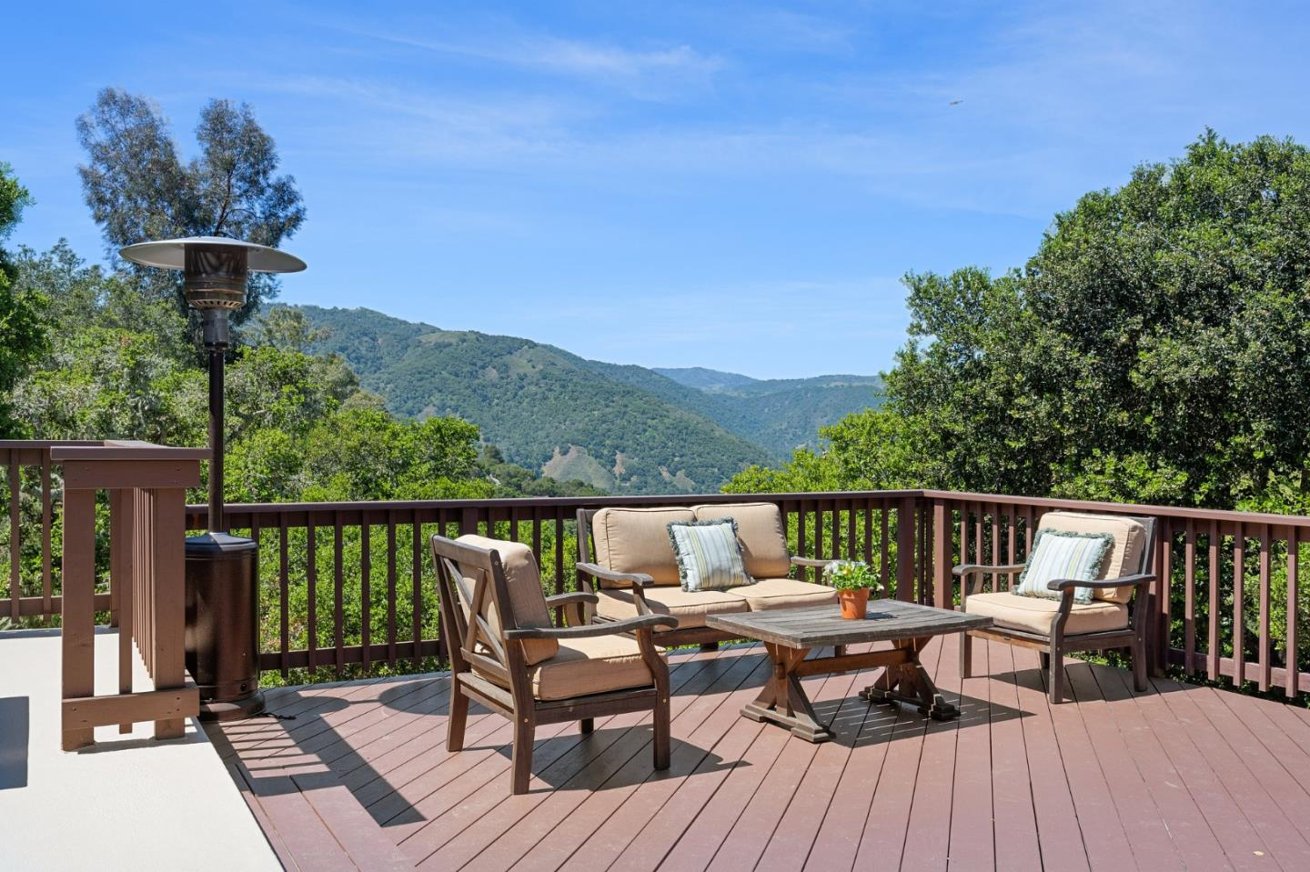 Turnkey Carmel Valley four-bedroom and three-bath home with big Garland Park views that is built to maximize the indoor-outdoor living afforded by the area's ideal climate. Off the gourmet kitchen is a patio that basks in the morning sun. The open kitchen with sit-up counters leads right into the living room with a luxurious fireplace, mountain views and double-sets of French doors that open to the expansive deck with southern exposure. On the main level there is an owners' suite and two guest bedrooms along with an addition family room with rich oak wood floors. Downstairs is a separate en-suite that has exterior access to the lower patio and lawn. There is additional flex-space that can be an office, gym or game room. This home marries the warmth of the classic Carmel Valley adobe bricks with an updates like the new radiant heat system and an updated networked home. The homes location is close to amenities of Carmel Valley village and maximizes living the Carmel Valley lifestyle.