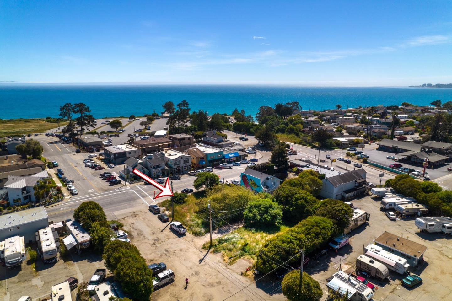 Exceptional Seacliff location with ocean views!  Vacant commercial lot zoned C-1 with multiple development opportunities.  Approximately 19,994 square foot parcel, just under 1/2 acre. Steps to the white sand beaches of Seacliff State Park and in the heart of one of Santa Cruz's most famous beach towns, Seacliff Beach.  Large, level parcel with multiple thriving and long standing businesses surrounding this future development site including Manuel's Mexican Restaurant and Marianne's Ice Cream.  Just outside the main entrance to California State Park Seacliff Beach and above multi-million dollar homes of Las Olas Drive.  C-1 zoning allows a wide range of flexible development proposals including residential, commercial, retail, hotel and more.  Ocean views from a proposed second story and walk to the beach make this commercial lot a rare find.  Over 19,900 square feet with utilities available at the street level.  A+ location.