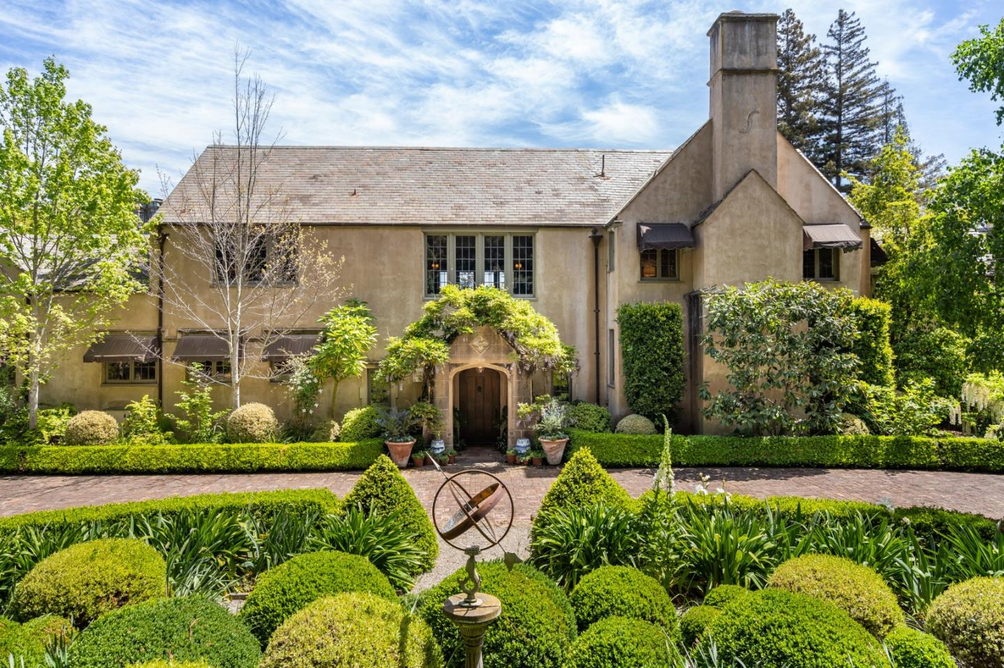 """Built in the mid 1920s, """"Treehaven"""" was designed by George Howard Jr., a member of the first American family to settle in the area named, Hillsborough. The current owners have beautifully restored and modernized this one-of-a-kind property.  Now """"Treehaven"""" awaits a new owner. It has that unique quality of design and elegance, that makes it a true setting for family gatherings, galas, and wonderful memories. Featuring over 1.5 acres of professionally manicured gardens, walkways and lawns, this is truly a special property.   Home Features Include: 66,000sf lot, 7160st of Living Space, 5 Bedrooms, 7 Bathrooms, 2 Half Baths, Formal Living/Dining Room, Lead Glass Enclosed Breakfast Area, Master Suite with his/hers Bathroom, Guest House, Gourmet Chefs Kitchen with Wolf Stove and Sub-Zero Refrigerator, Family Room with Fireplace, Office with Private Bathroom, Indoor and Outdoor Pool, Lanai, Tennis Court, 4-Car Garage, Updated Electrical and Plumbing, Lead Glass Windows and Period Details!"""