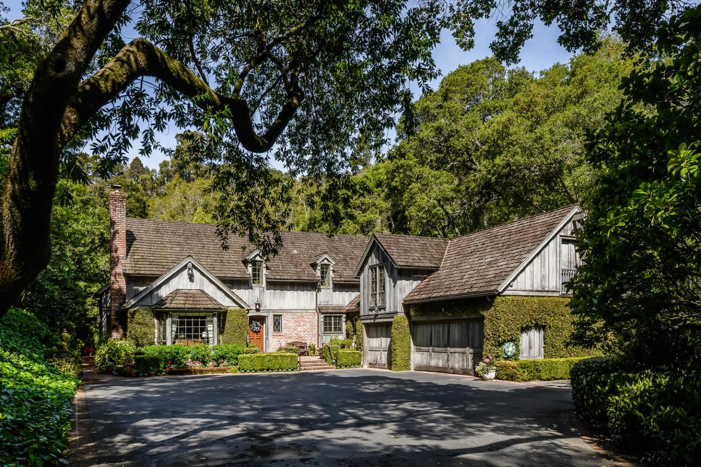 Rare and wonderfully private 3.4 acre classic estate with a tastefully updated 5,200 sf traditional home amid a vibrant landscape of Redwoods, heritage Oaks, giant Bay Laurels in the exclusive 2-acre area of Hillsborough. This bucolic refuge is a fabulous example of the timeless beauty of the Bay Area foothills with a contemporary 6BD/5.5BA English Cottage style home offering a superb layout and amenities including: quintessential indoor/outdoor living, spacious rooms with elegant custom tile and millwork, cherrywood library, chefs kitchen, luxury bathrooms, hand tiled hot tub, 3-car garage, and more. Primary suite with garden French doors and spa-like bath, 5 additional bedrooms; 3 en suites. Gracious family room and adjoining art room with vaulted open-beam ceilings, formal living and dining rooms. Nestled along an exclusive winding street, this Hillsborough gem is just minutes from shopping, award-winning dining and some of the Peninsulas best open space preserves.