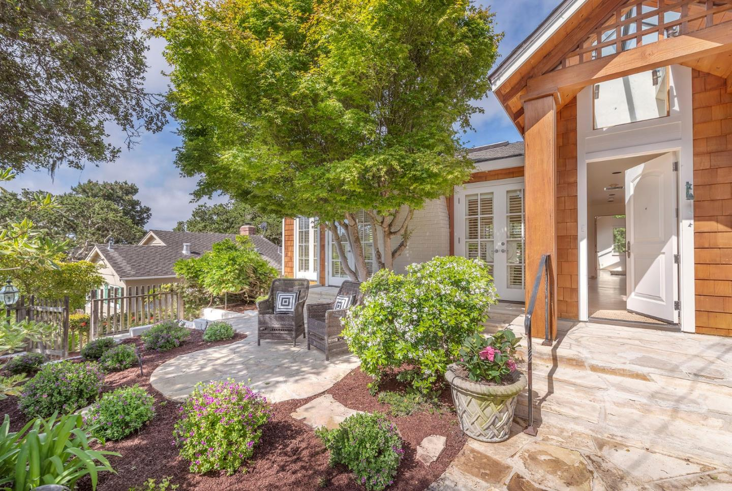 Do you know that feeling you get when you know you have found something special?  That is the feeling you will experience when you arrive at this sweet retreat by the Sea.  Loved and owned by the same family for over 25 years, the captivating cottage sits on a quiet street South of Ocean Avenue, just above downtown Carmel by the Sea.  The wonderful single-level home has a open floor plan that conveys warmth and spaciousness.  The beamed vaulted ceilings and skylights shower the home with sunlight. The home is filled with windows that look out to the private and gracefully landscaped yard, it is a perfect setting to read, take in long talks with friends and to dine under the stars. The home recently received a lovely cosmetic refresh, including all new kitchen appliances and is ready to welcome its new owner. This unique offering includes a 2BD/2BA main house, a detached 1BD/1BA guest house and a spacious 1BA studio/apartment to be used as one desired, from art studio to in-law suite.