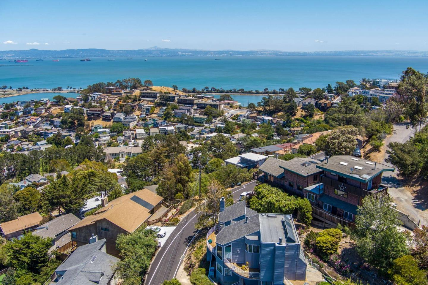 This is it!  Very spacious home with spectacular views of downtown San Francisco, the Bay Bridge, the Bay and San Bruno Mountain.  It features an open floor plan with a spacious living room/dining combination. There is a beautifully remodeled master suite upstairs.  The recreation room is huge and has a 1/2 bath, which could easily be turned into a full bath.  Many skylights.  Mostly wood floors.  Additionally, there are two separate spaces. Both of them have amazing views and are in wonderful condition.  Large 2 car garage with extra storage, as well as 6 other parking spaces around the property.  Waterfalls, pond, hot tub overlooking the bay and 3 decks, plus a yard.  One of the best things is that even though you are on top of the world, there are not tons of stairs and no stairs between the garage and the main house.  There are beautifully designed (not permitted) plans to connect all of the home together.  Don't miss this truly special property!